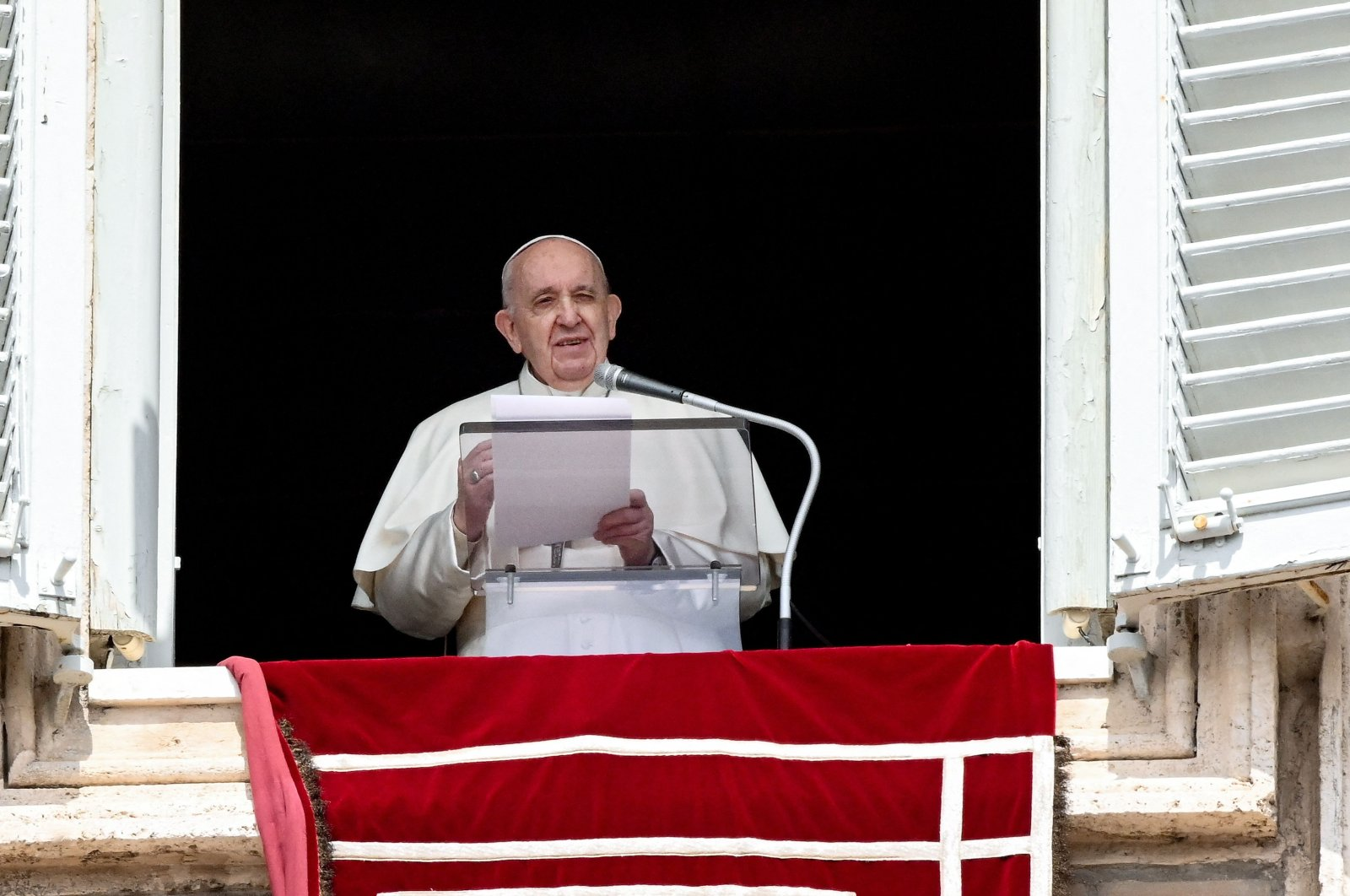 Pope Francis leads the recitation of the Regina Coeli prayer from the window of the apostolic palace overlooking St. Peter's Square in Vatican City, April 18, 2021. (AP Photo)