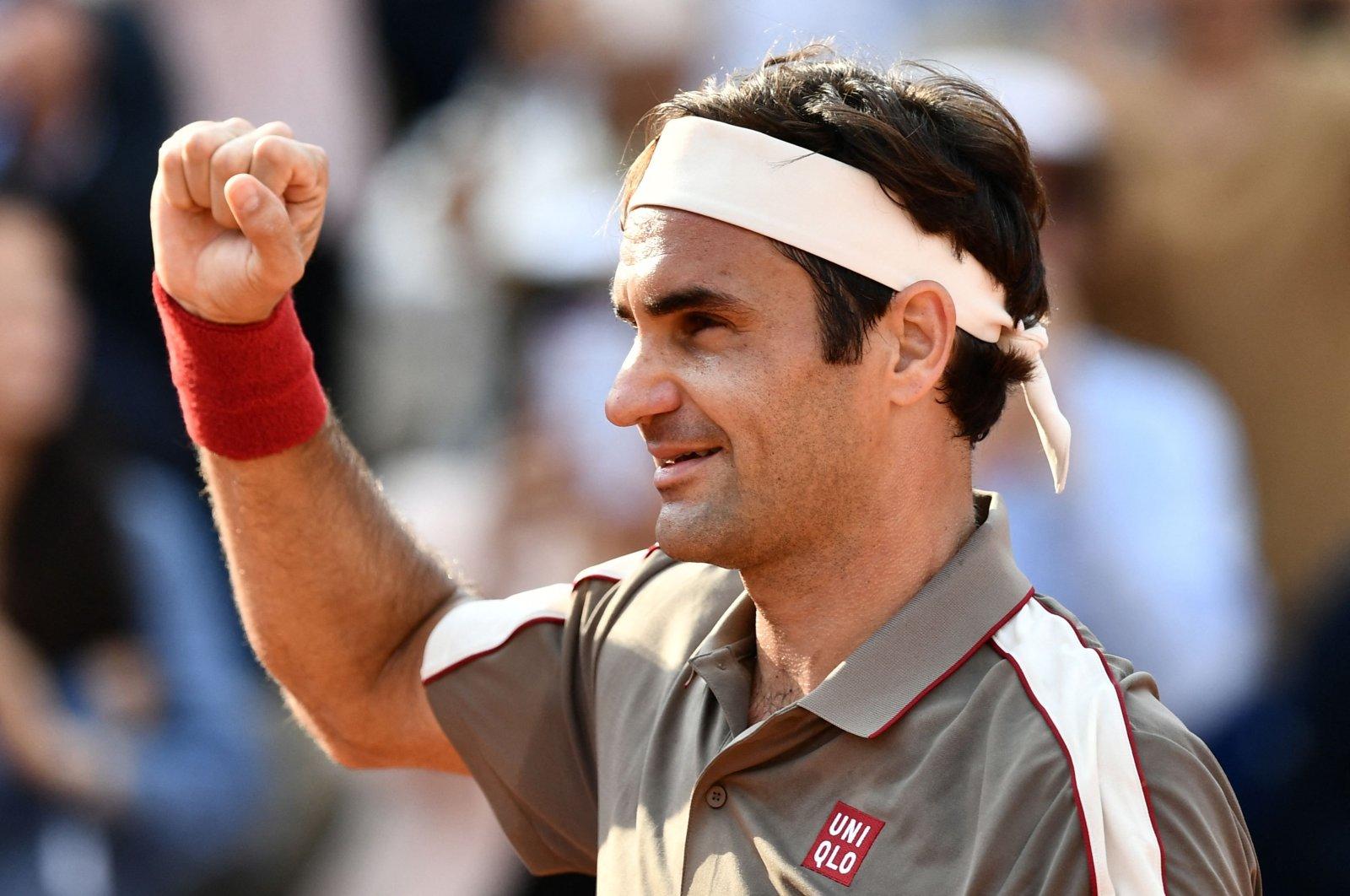 Switzerland's Roger Federer celebrates after winning against Switzerland's Stanislas Wawrinka during their men's singles quarter-final match on day 10 of The Roland Garros 2019 French Open tennis tournament in Paris, June 04, 2019. (AFP Photo)