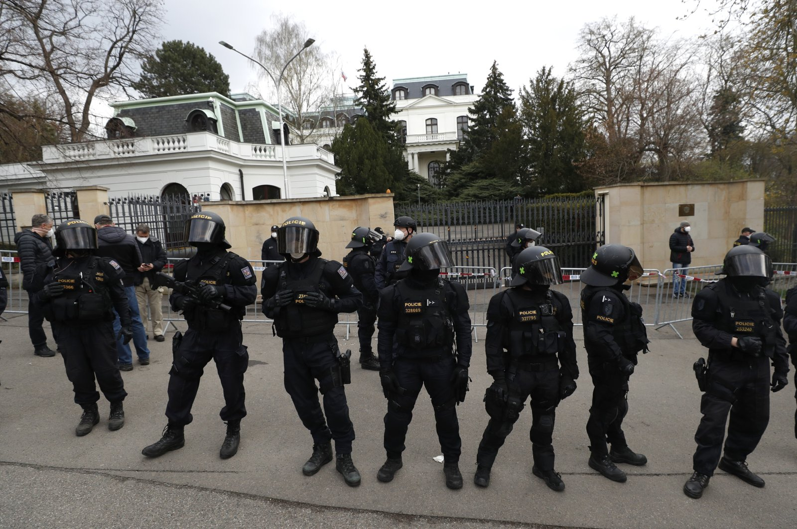 Riot police guard the area as protesters gather in front of the Russian Embassy in Prague, Czech Republic, April 18, 2021. (AP Photo)