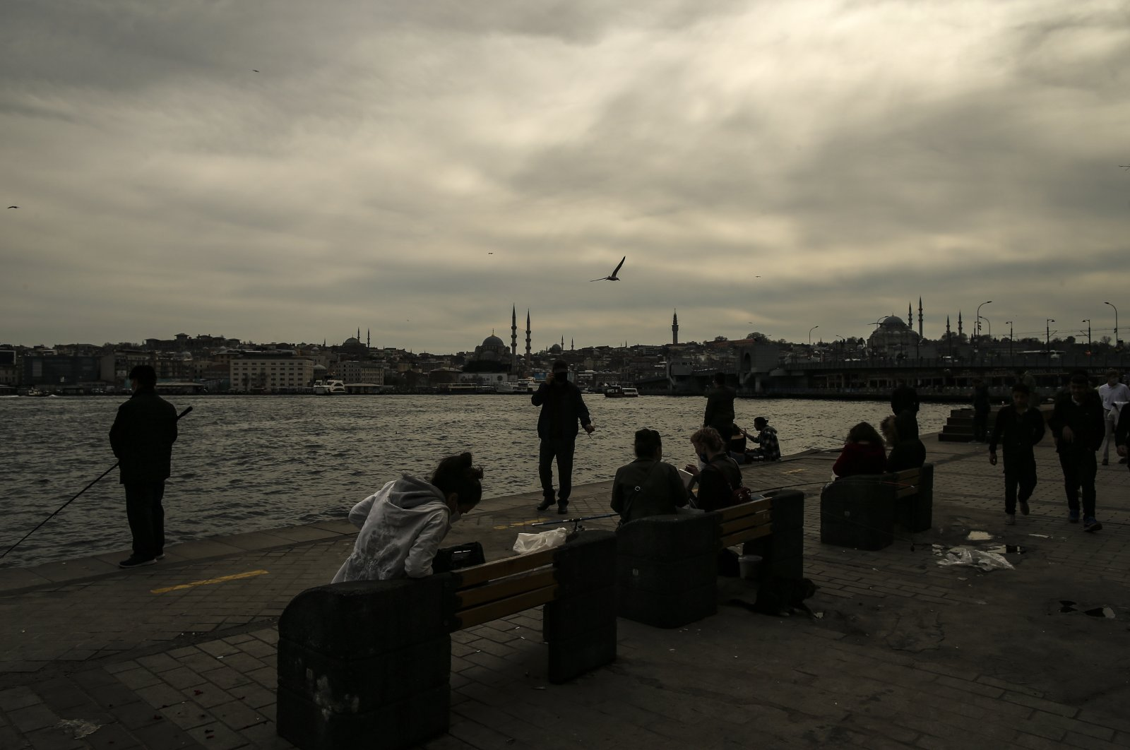People near Golden Horn, in Istanbul, Turkey, April 13, 2021. (AP Photo)