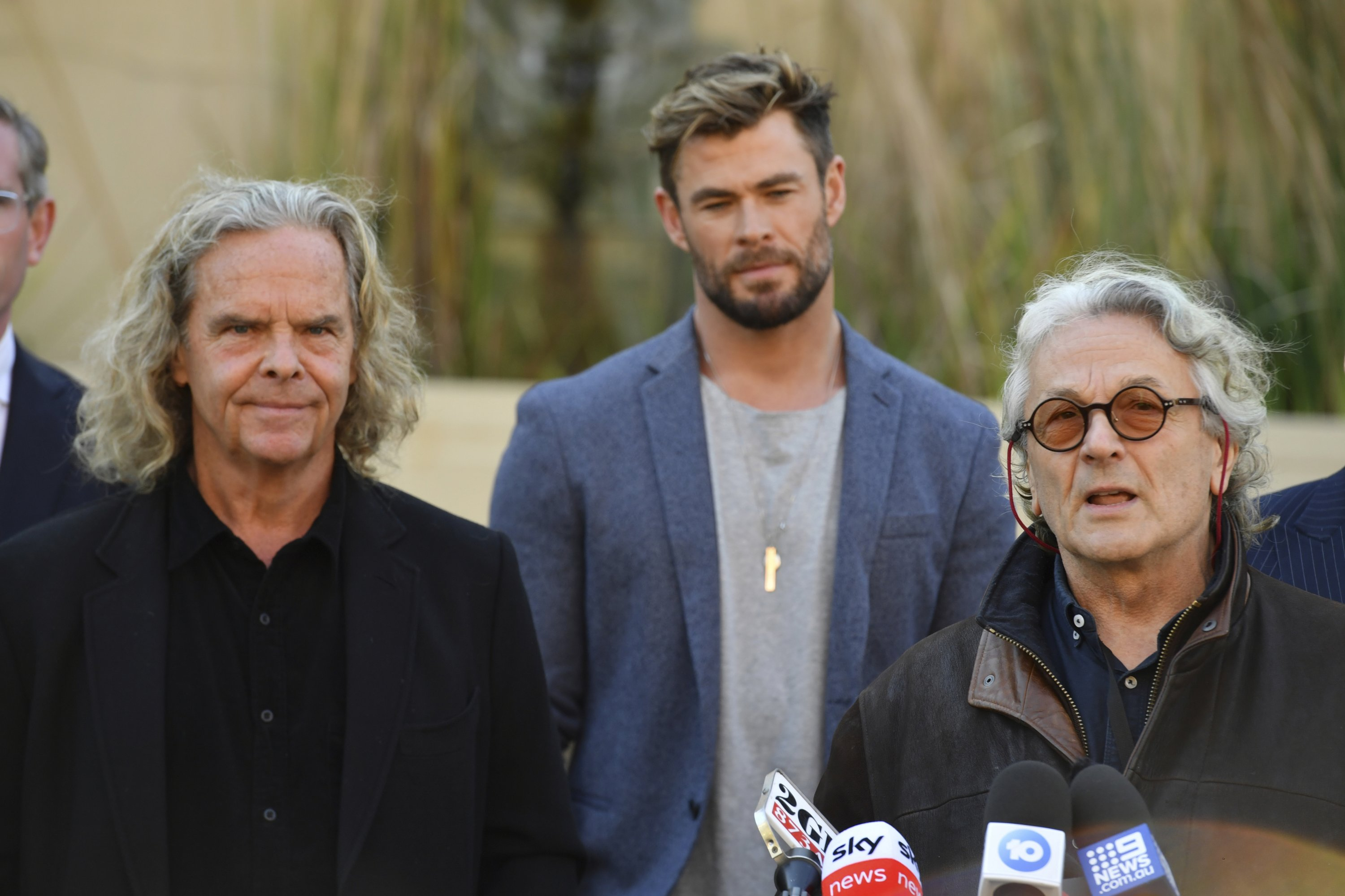 Producer Doug Mitchell (L), actor Chris Hemsworth (C) and director George Miller attend a press conference to announce the new 'Mad Max' film at Fox Studios in Sydney, Australia, April 19, 2021. (AP Photo)