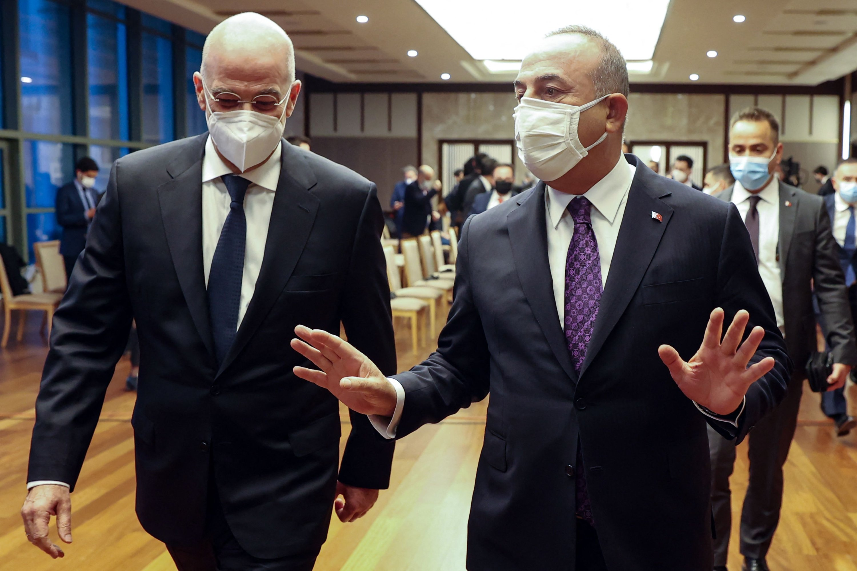 Greece's Foreign Minister Nikos Dendias (L) and Foreign Minister Mevlüt Çavuşoğlu arrive to hold joint press conference following their meeting in Ankara, Turkey, April 15, 2021. (AFP Photo)