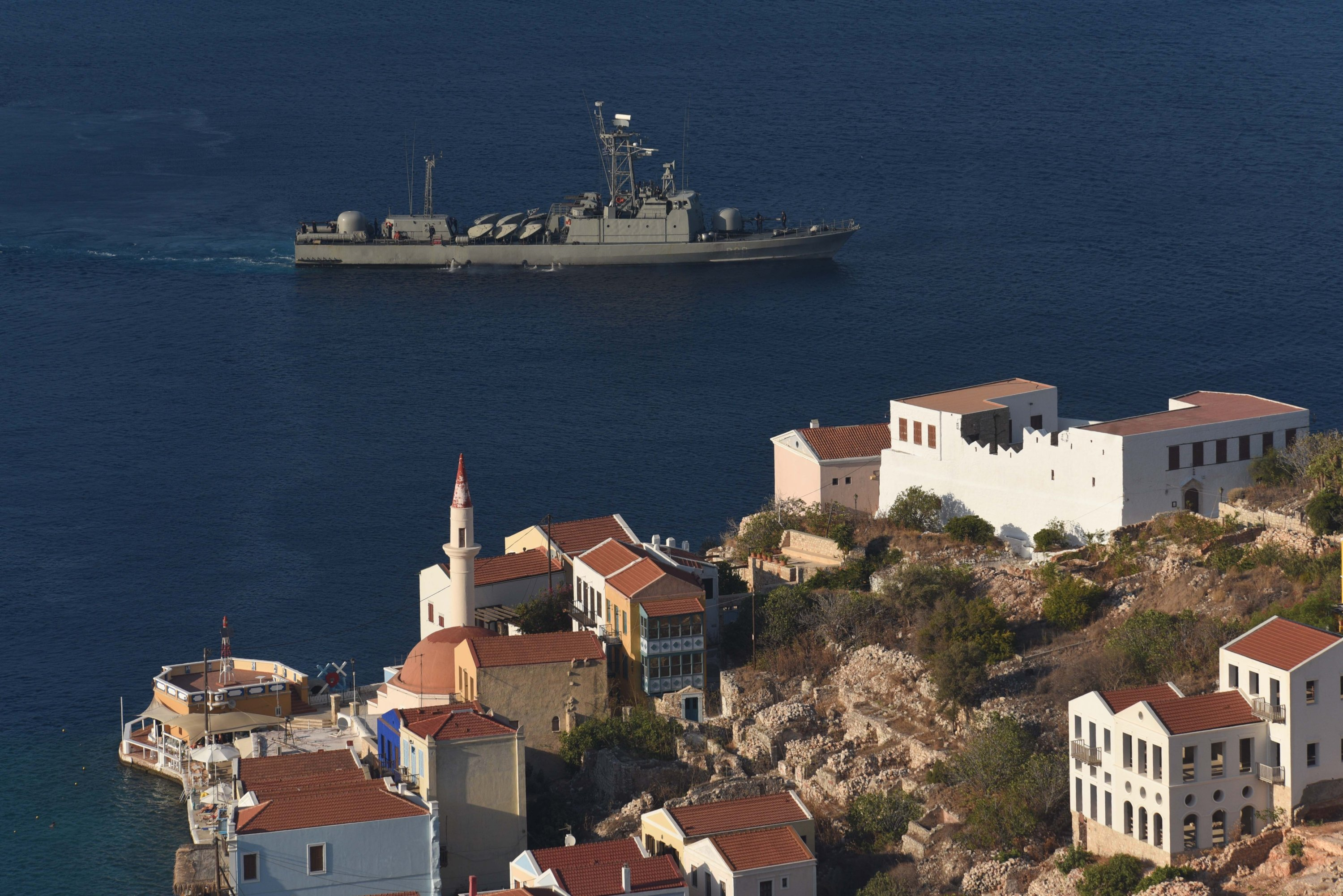 A Greek navy warship heads off the island of Kastellorizo (Megisti-Meis), with the coast of Turkey visible far in the background, Greece, Sept. 8, 2020. (Reuters Photo)