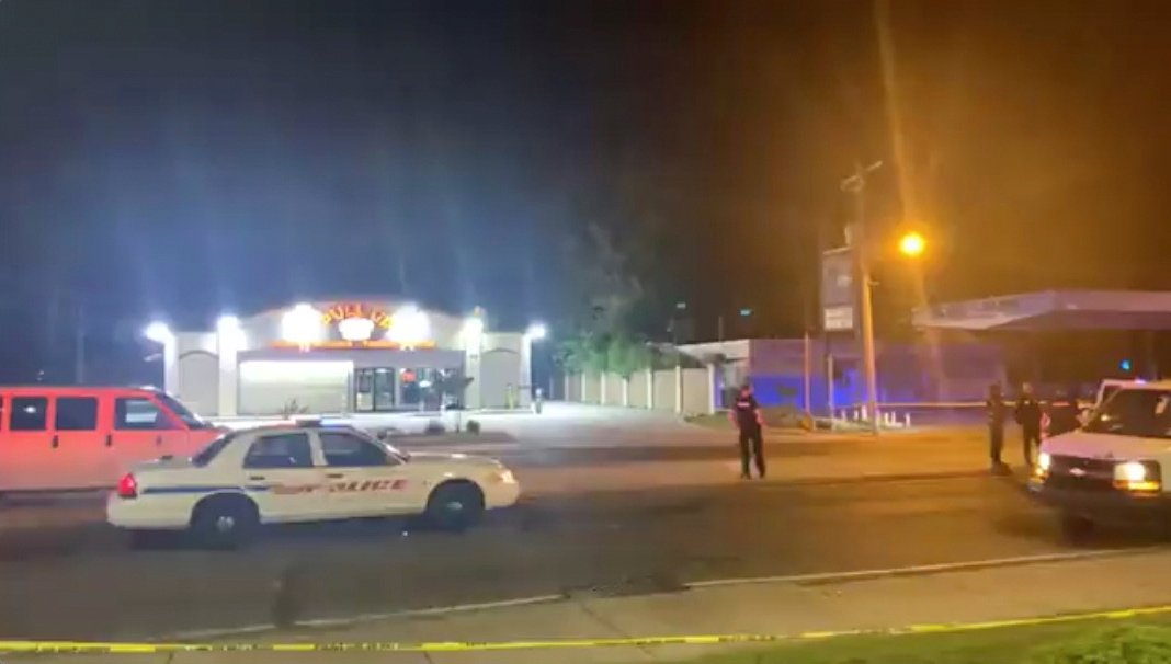 Police personnel and their vehicles are seen near the scene in the aftermath of a drive-by shooting at a liquor store in Shreveport, Louisiana, U.S., April 18, 2021. (Love Shreveport-Bossier via Reuters)