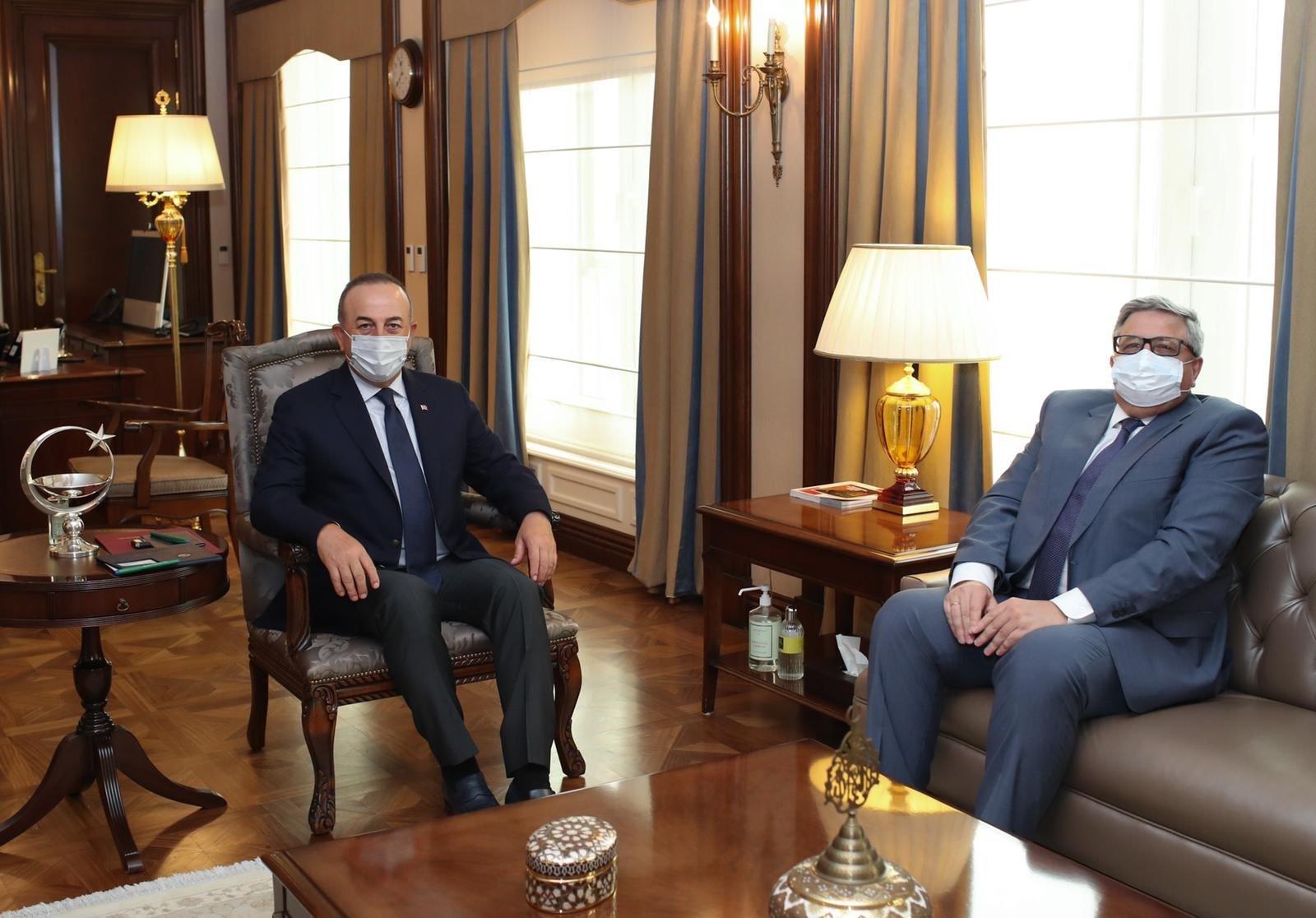 Foreign Minister Mevlüt Çavuşoğlu (L) with Russian Ambassador Aleksei Erkhov in Ankara, Turkey, April 19, 2021. (DHA Photo)
