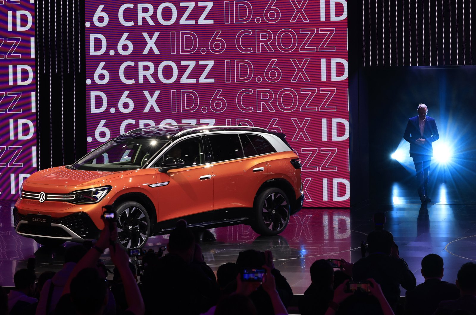 Stephan Wollenstein, CEO of Volkswagen Group China, prepares to present the ID 6 SUV during a launch event at the Shanghai Auto Show in Shanghai, China, April 19, 2021. (AP Photo)