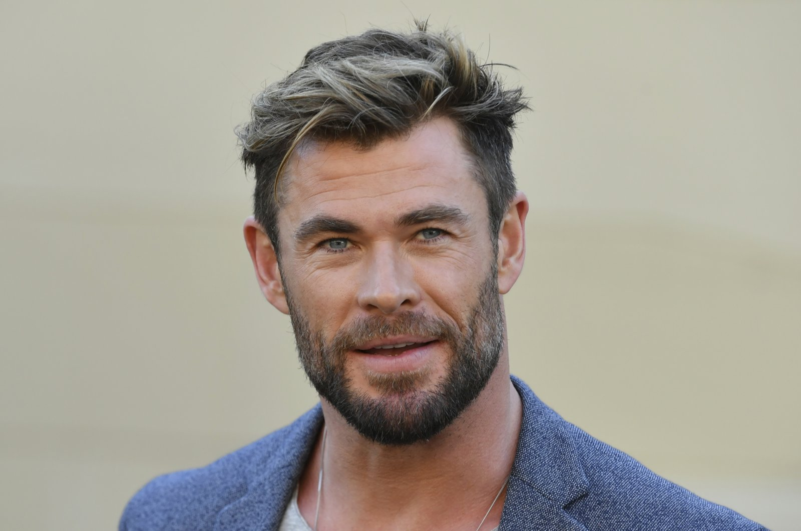 """Actor Chris Hemsworth attends a press conference to announce the new """"Mad Max"""" film at Fox Studios in Sydney, Australia, April 19, 2021. (AP Photo)"""