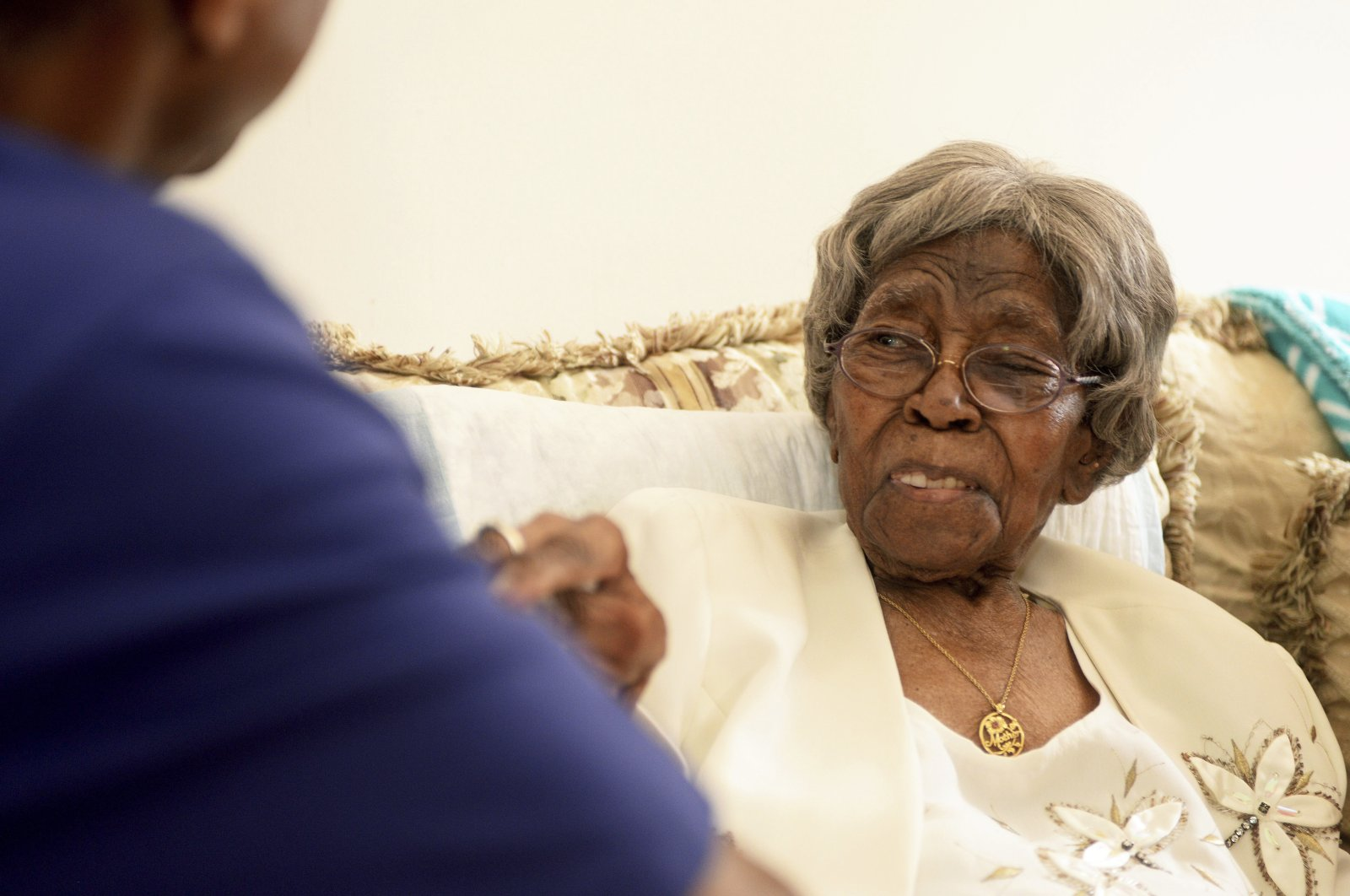"""Roosevelt Patterson greets his grandmother Hester """"Granny"""" Ford during Ford's 111th birthday party, North Carolina, U.S., Aug. 13, 2016. (AP Photo)"""
