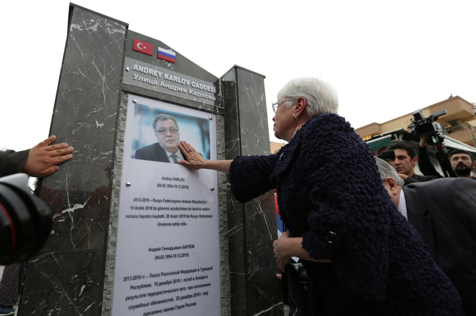 Marina Karlova, the widow of Andrei Karlov, touches a photo of the late envoy at a ceremony to name a street after him, in Antalya, southern Turkey, March 22, 2018. (REUTERS PHOTO)