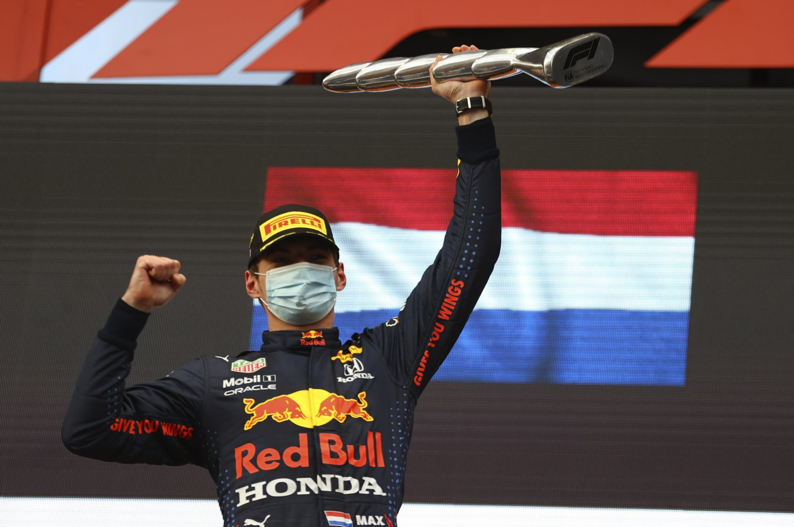 Red Bull's Max Verstappen celebrates on the podium at the end of the Emilia-Romagna Formula One Grand Prix, at the Imola racetrack, Italy, April 18, 2021. (AP Photo)
