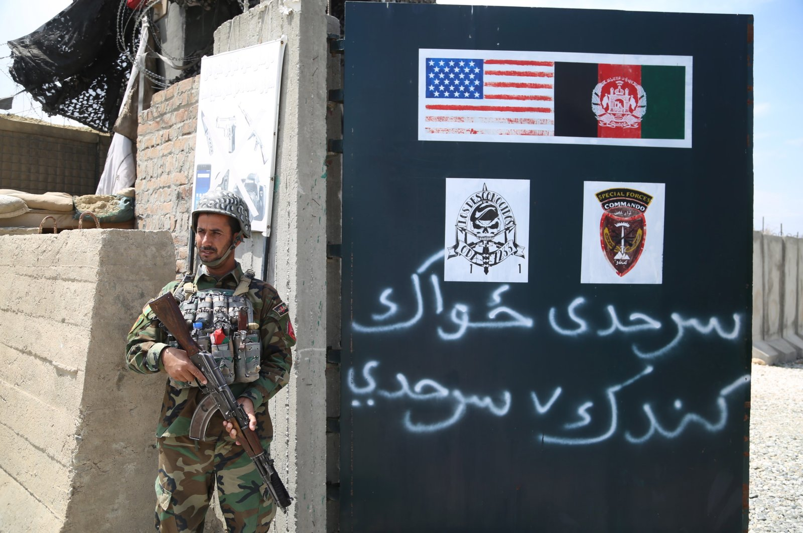 An Afghan Army soldier stands guard outside a military base that was previously in use by the U.S. soldiers, in Haska Meyna district of Nangarhar province, Afghanistan, April 14, 2021. (EPA Photo)