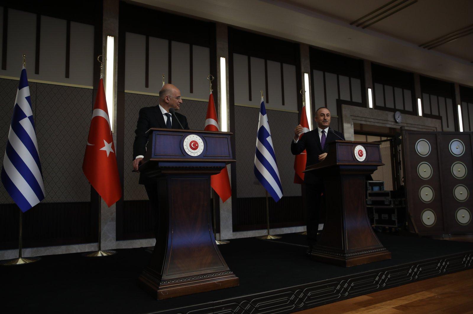 Greek Foreign Minister Nikos Dendias, left, looks on, as Turkish Foreign Minister Mevlüt Çavuşoğlu, right, gestures as he talks during a joint media statement following their meeting in Ankara, Turkey, April 15, 2021. (AP Photo)