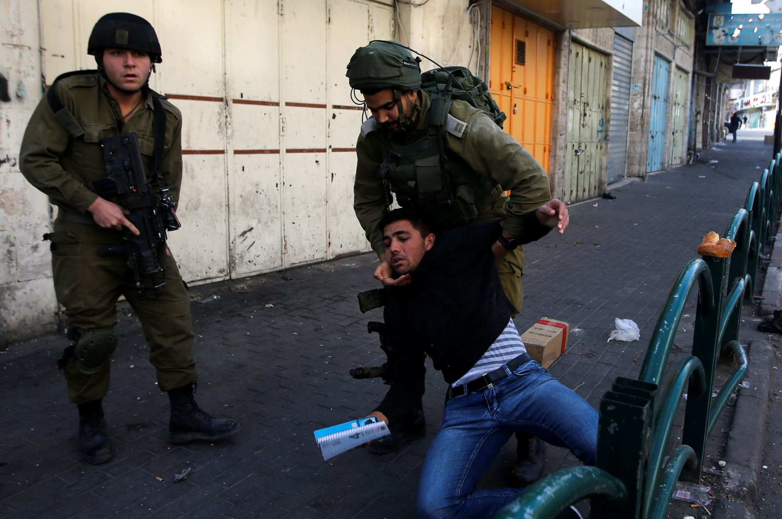 Israeli soldiers detain a Palestinian during clashes at a protest against U.S. President Donald Trump's decision to recognize Jerusalem as the capital of Israel, Hebron, West Bank, Dec. 10, 2017. (Reuters Photo)