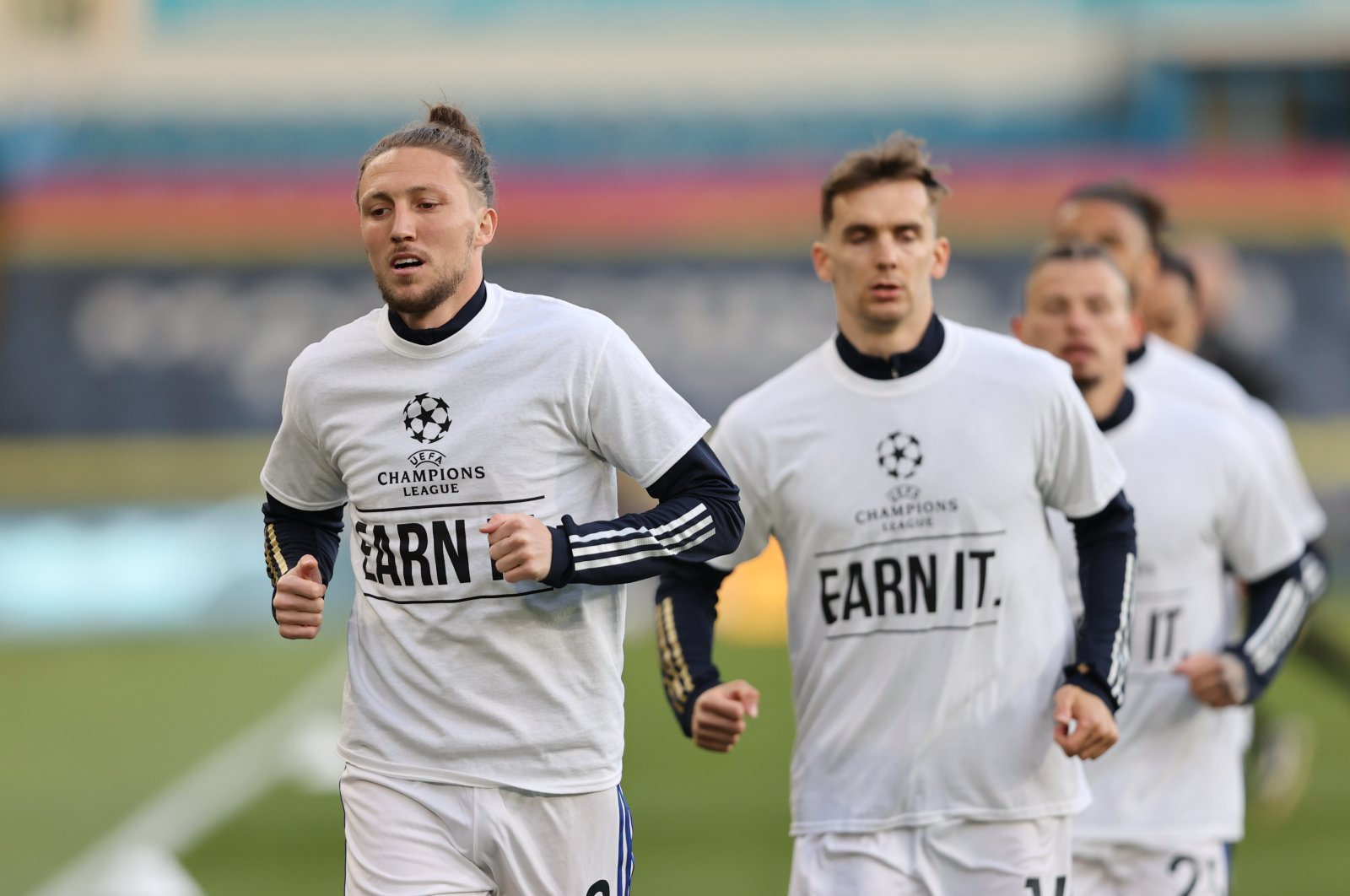 "Leeds United's Luke Ayling and Diego Llorente during the warmup before the match wearing UEFA Champions League T-Shirts with messages saying ""Earn It"" at the Elland Road Stadium in Leeds, U.K., April 19, 2021. (Pool via Reuters)"