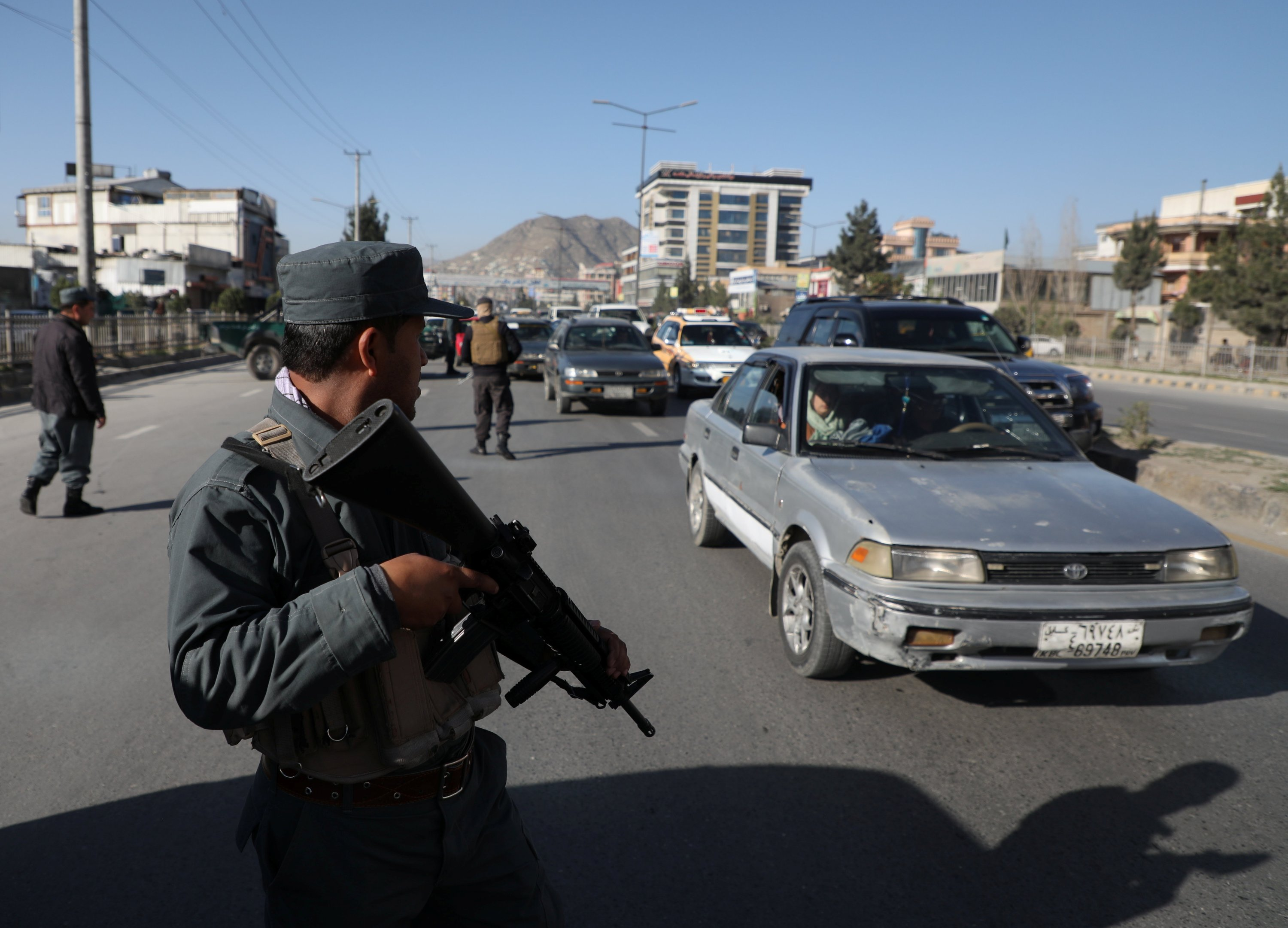 Afghan policemen keep watch at a checkpoint in Kabul, Afghanistan, April 19, 2021. (Reuters Photo)
