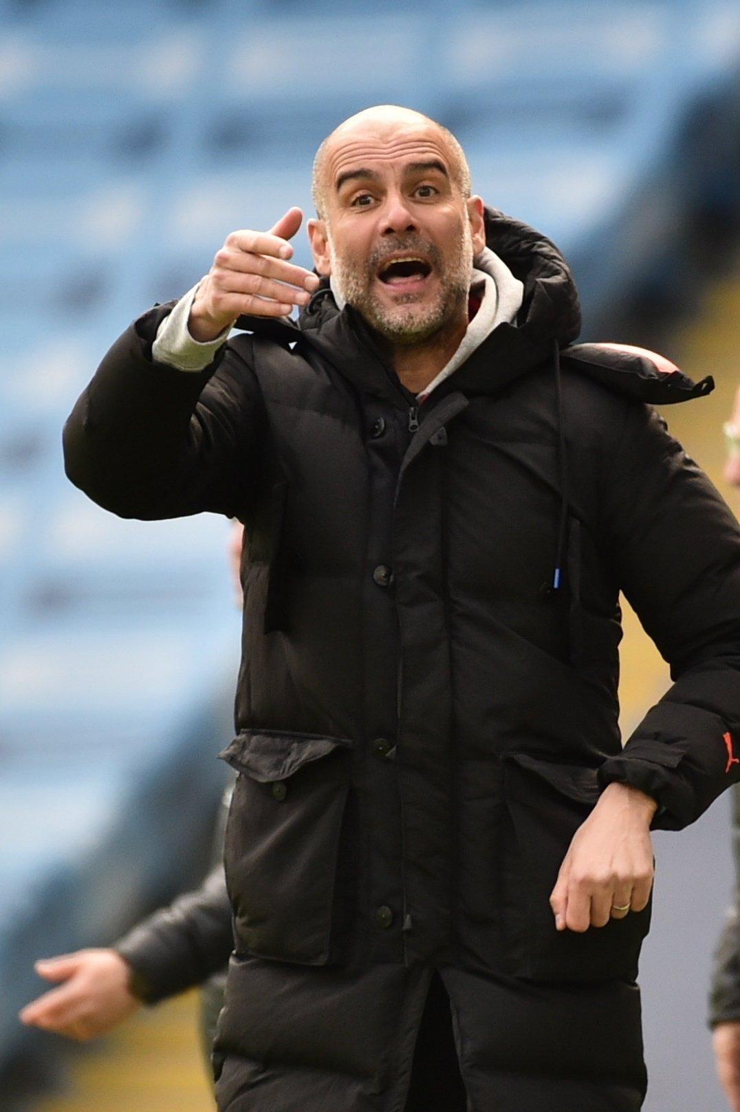 Manchester City manager Pep Guardiola gestures during a Premier League match against Leeds United, Manchester, Britain, April 10, 2021. (EPA Photo)