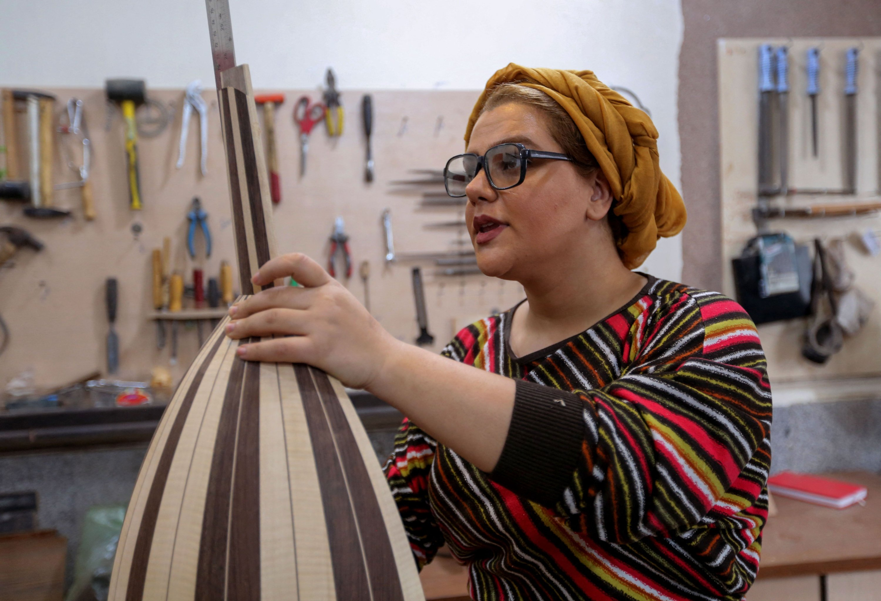 Iranian luthier Fatemeh Moussavi builds a oud at her workshop in the capital Tehran, Iran, Dec. 14, 2020. (AFP Photo)