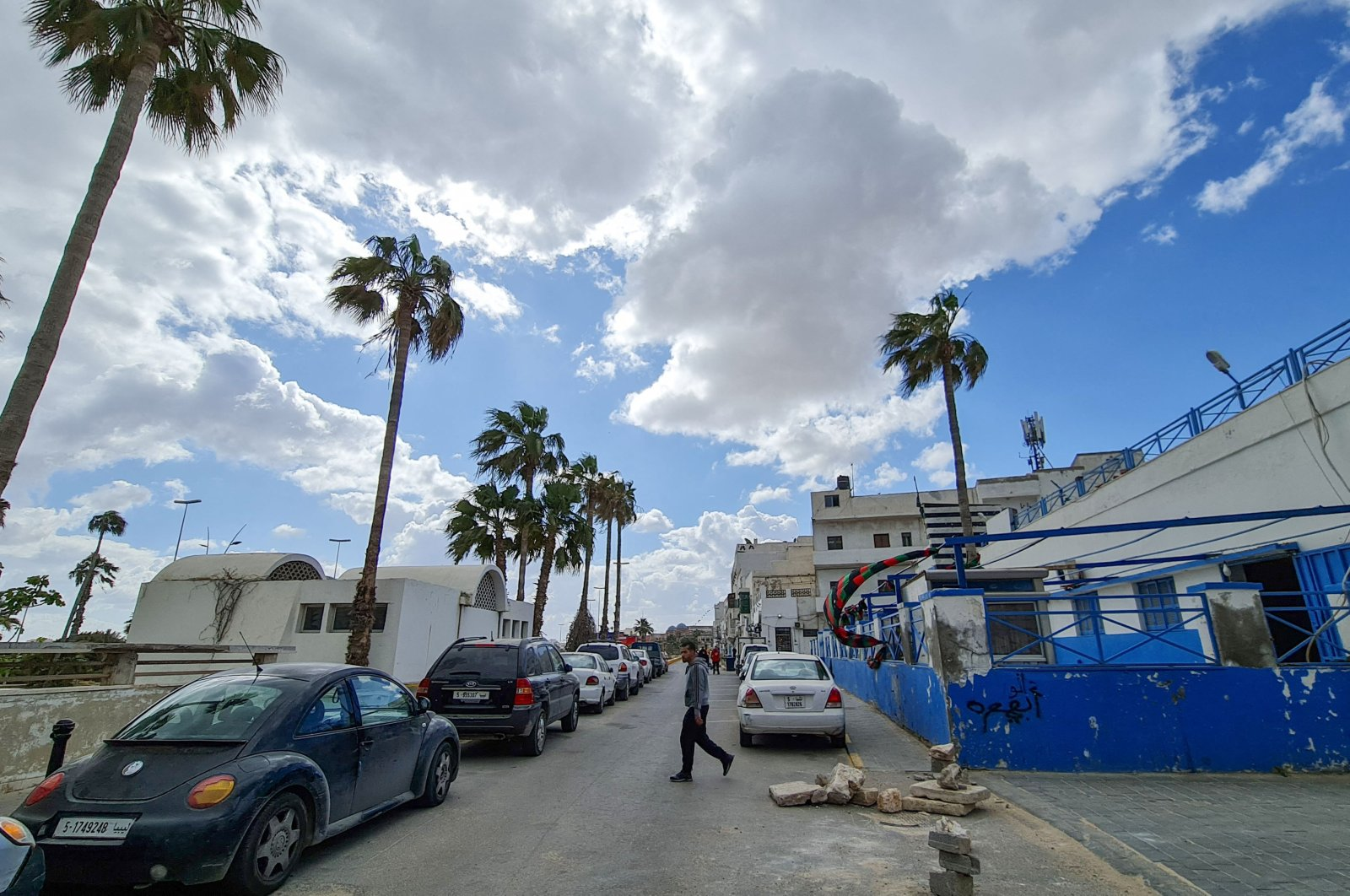 A man crosses a street in the Libyan capital Tripoli's old city, amid ongoing infrastructure rehabilitation work, March 23, 2021. (AFP Photo)