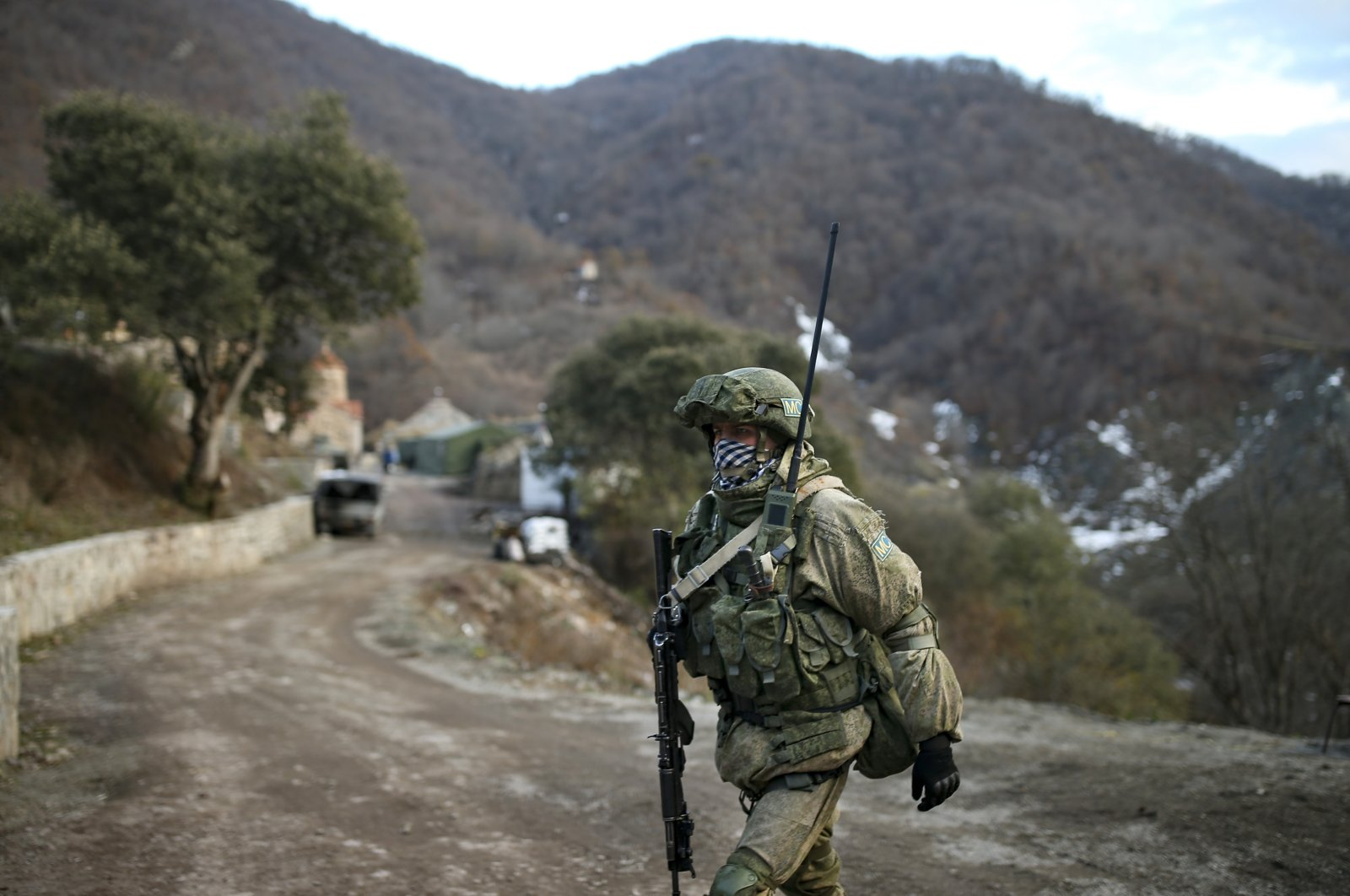 A Russian peacekeeper guards an entry point of Dadivank, an Armenian Apostolic Church monastery dating to the 9th century, after the transfer of the Kalbajar region back to Azerbaijan as part of a peace deal that required Armenian forces to cede Azerbaijani territories they previously occupied outside Nagorno-Karabakh, near Kalbajar, Azerbaijan, Wednesday, Dec. 2, 2020. (AP File Photo)