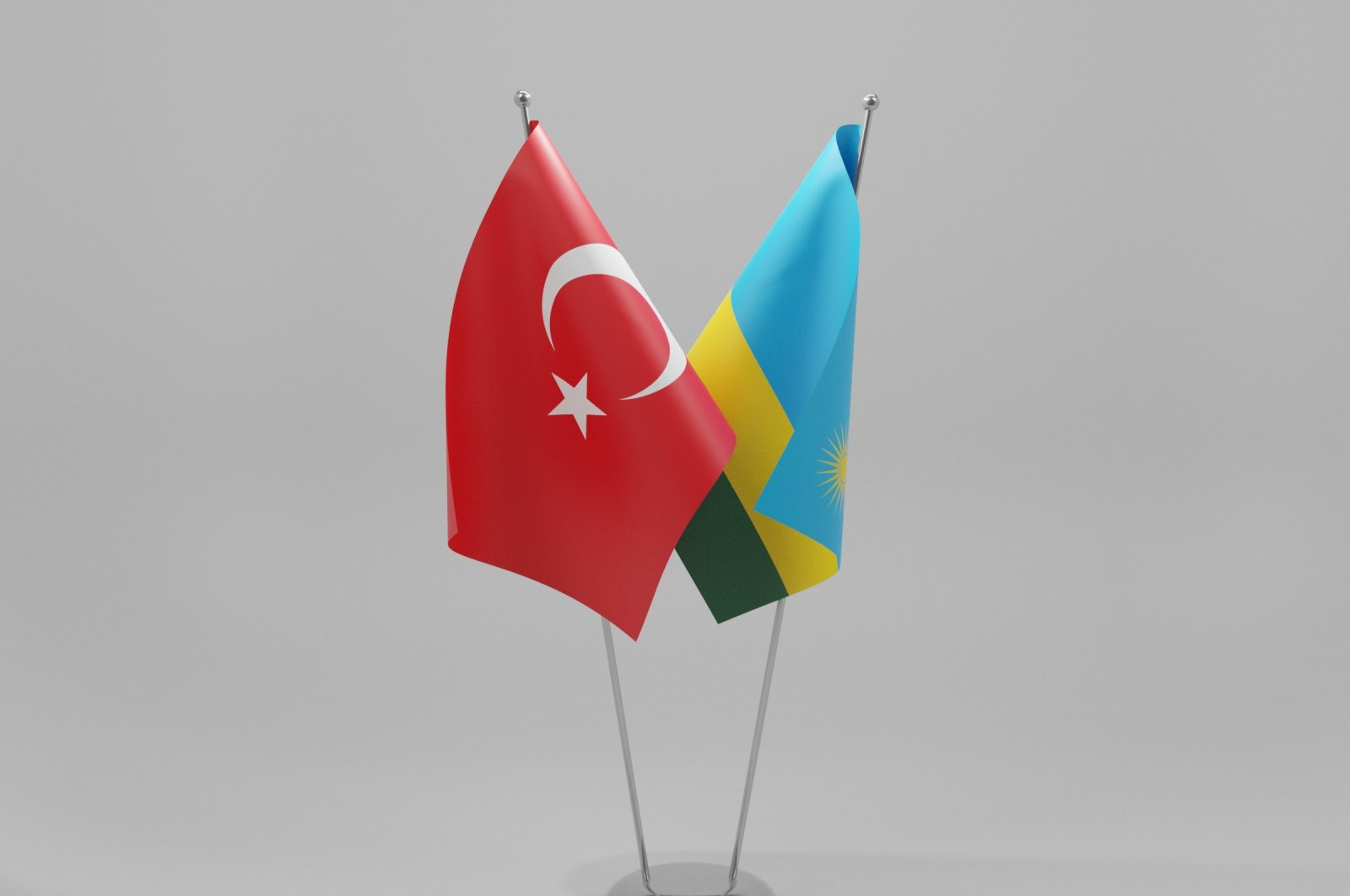 The flags of Turkey and Rwanda are pictured here together. (Shutterstock)