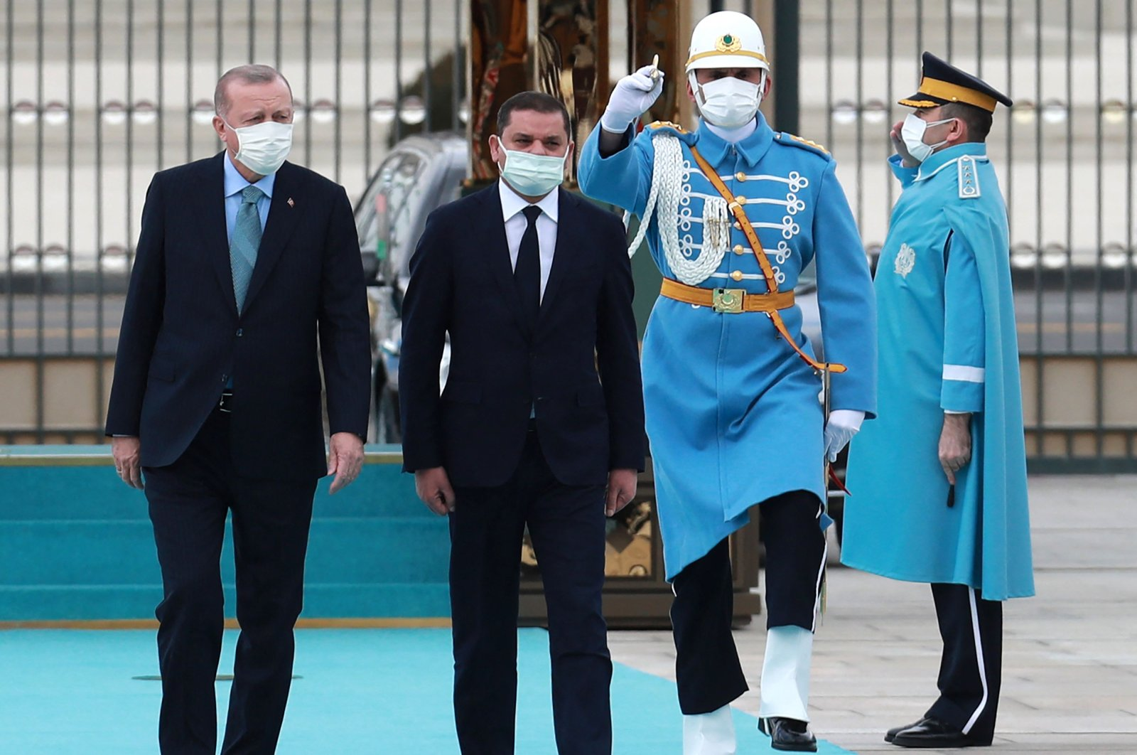 President Recep Tayyip Erdoğan (L) and Libyan Prime Minister Abdul Hamid Dbeibah walk past a guard of honor during the official ceremony prior to their meeting in Ankara, Turkey,  April 12, 2021. (AFP Photo)