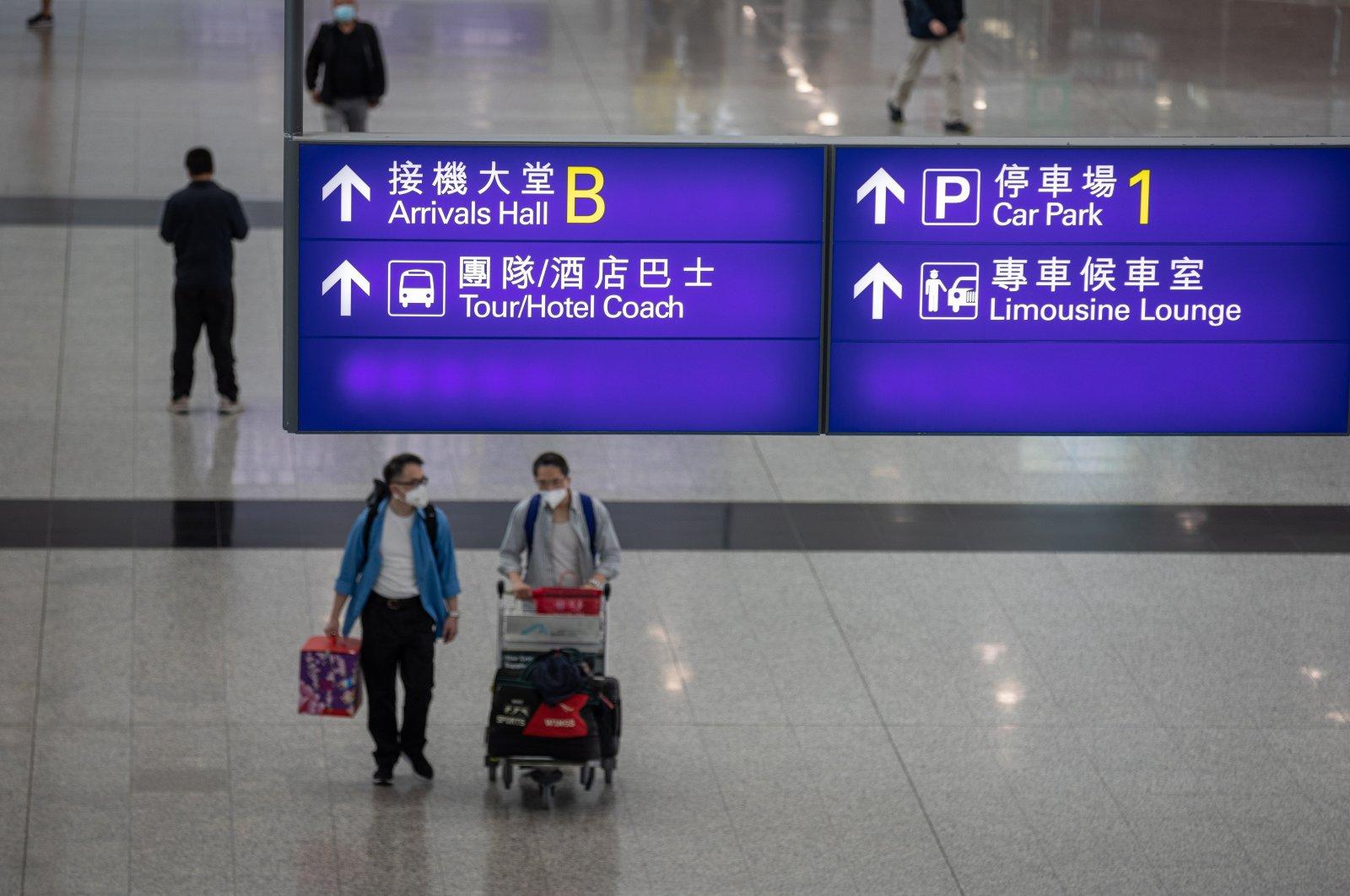 Passengers walk in the arrival hall at Hong Kong International Airport in Hong Kong, China, April 20, 2021. (EPA Photo)