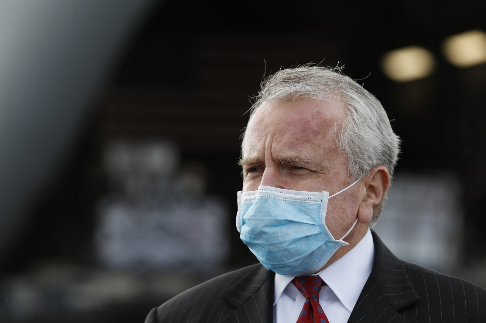 U.S. ambassador to Russia John Sullivan wearing a protective face mask stands next to a U.S. Air Force C-17 Globemaster transport plane at Vnukovo International Airport amid the outbreak of the COVID-19 pandemic, Moscow, Russia, May 21, 2020. (EPA Photo)
