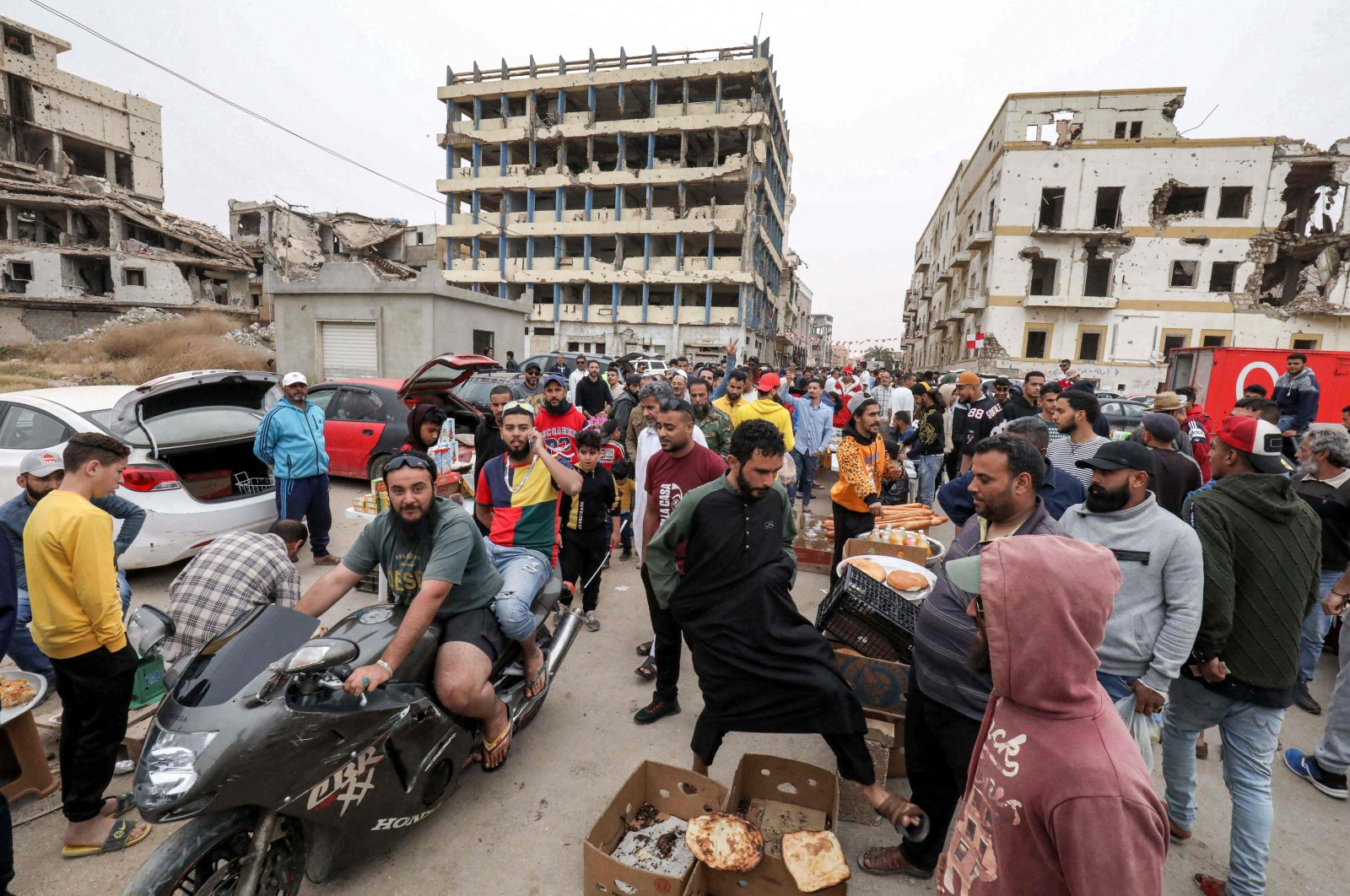 People shop at the Suq al-Hout (Whale Market) district during the Muslim holy month of Ramadan in the eastern city of Benghazi, Libya, on April 18, 2021. (Photo by Abdullah DOMA / AFP)