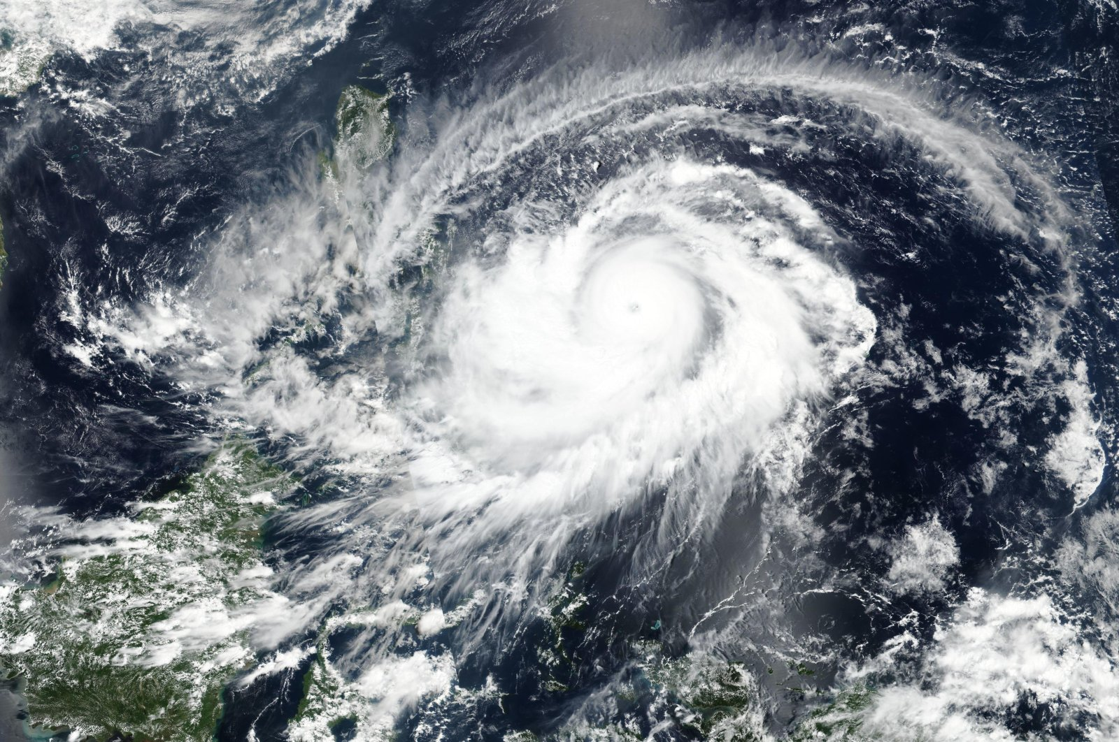A satellite image released NASA shows typhoon Surigae approaching Philippines, April, 17, 2021. (AP Photo)