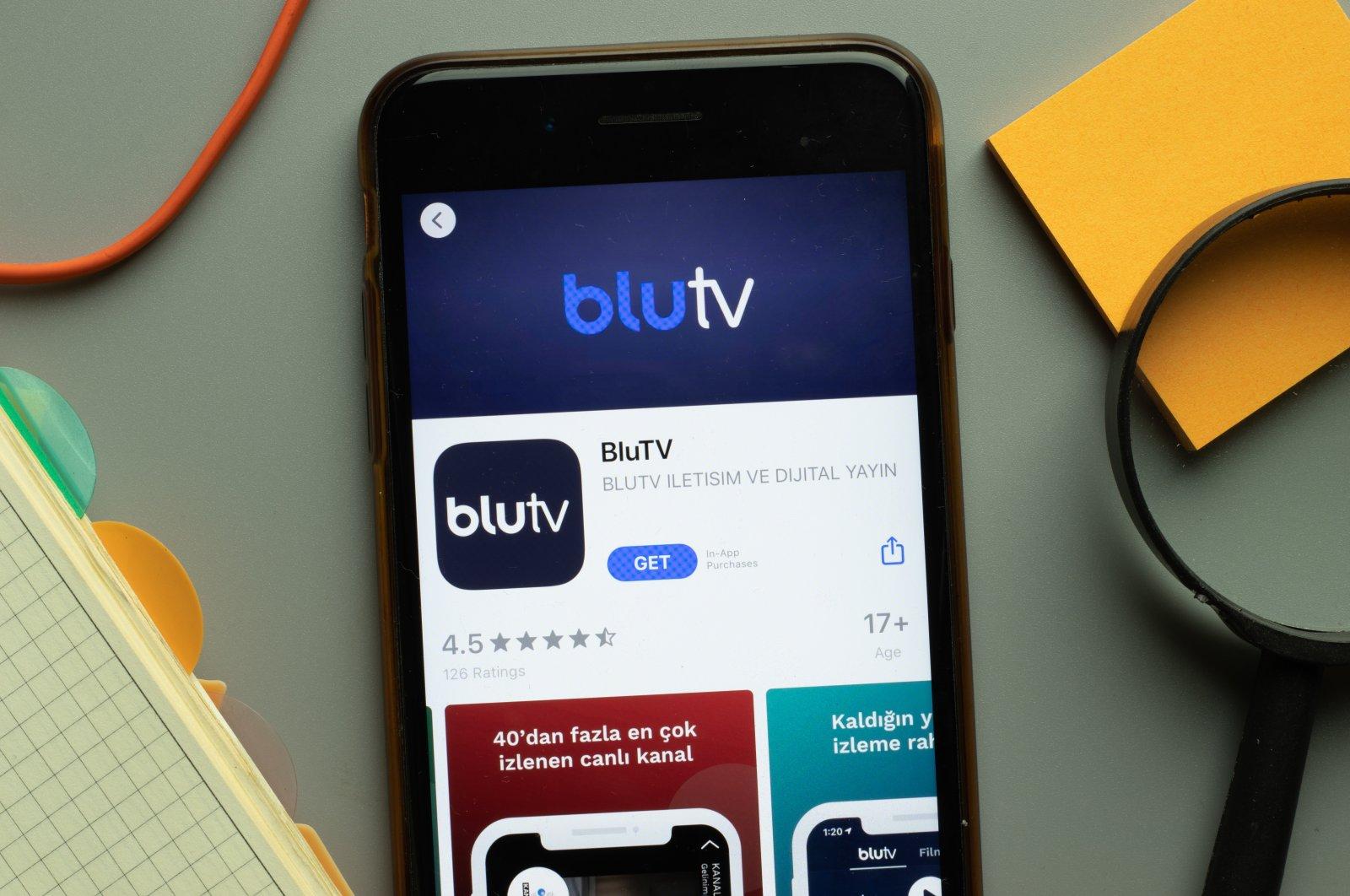 BluTV mobile app logo seen on a phone screen, New York, the U.S., Oct. 26, 2020. (Shutterstock Photo)