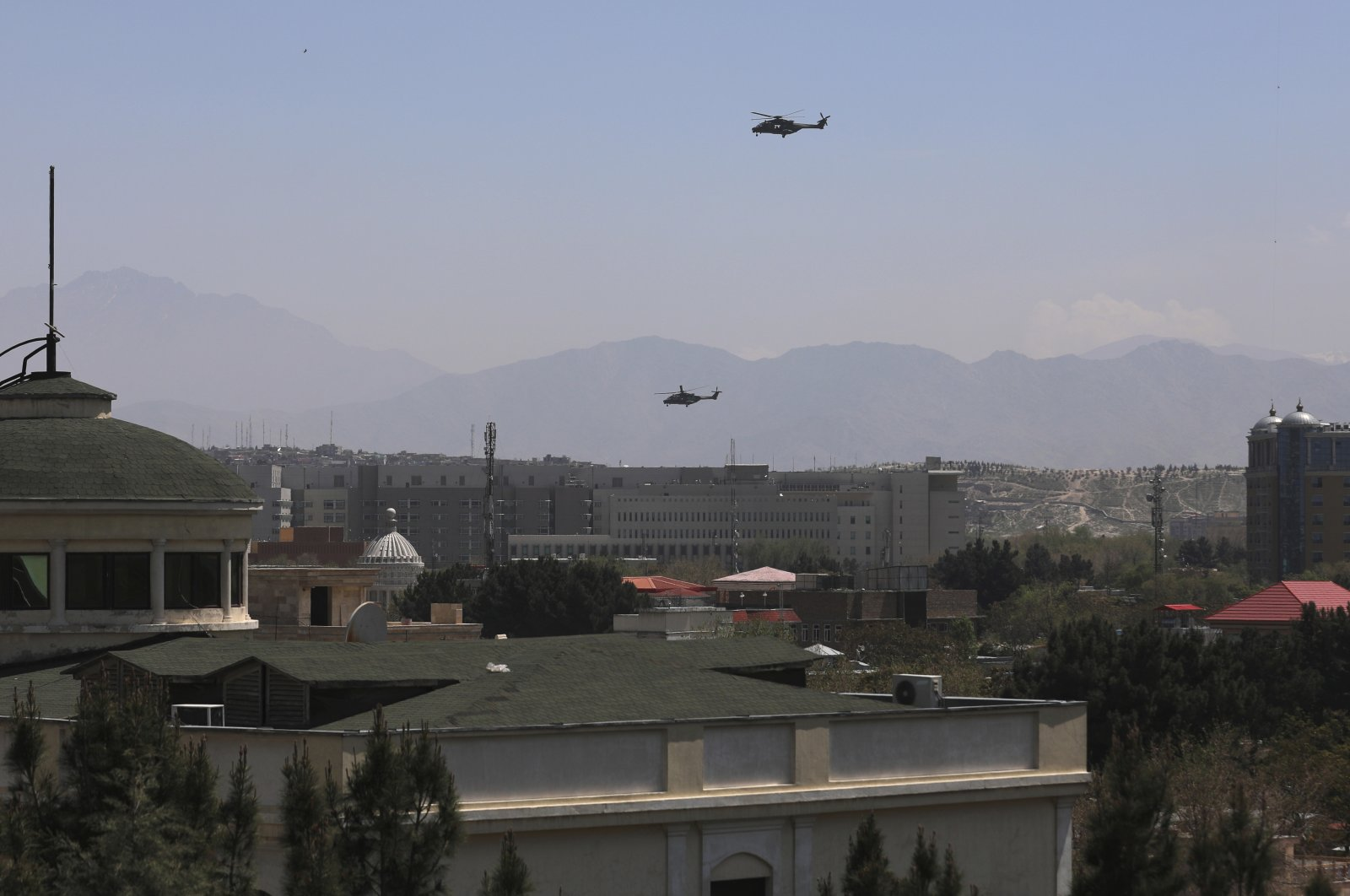 U.S. Black Hawk military helicopters fly over the city of Kabul, Afghanistan, Monday, April 19, 2021. (AP Photo)