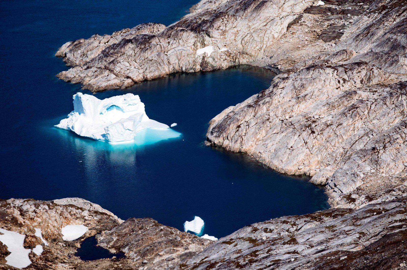 An aerial view shows an iceberg as it floats near Kulusuk, along the eastern coast of Greenland, Aug. 15, 2019. (AFP Photo)