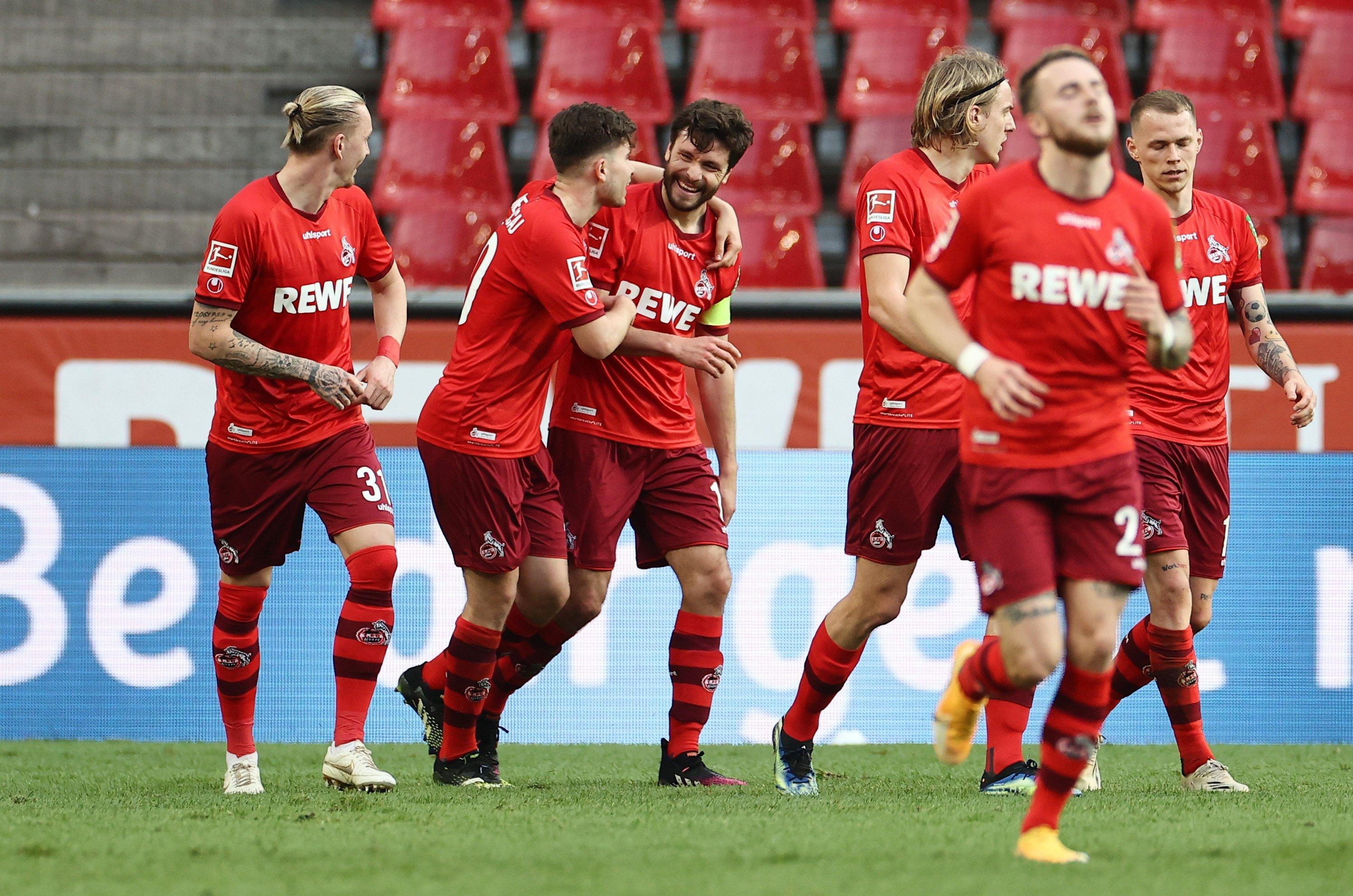 1 FC Koln's Jonas Hector (C) celebrates scoring their second goal against RB Leipzig with teammates during Bundesliga match on April 20, 2021. (Rolf Vennenbernd/DFL/Pool via Reuters)