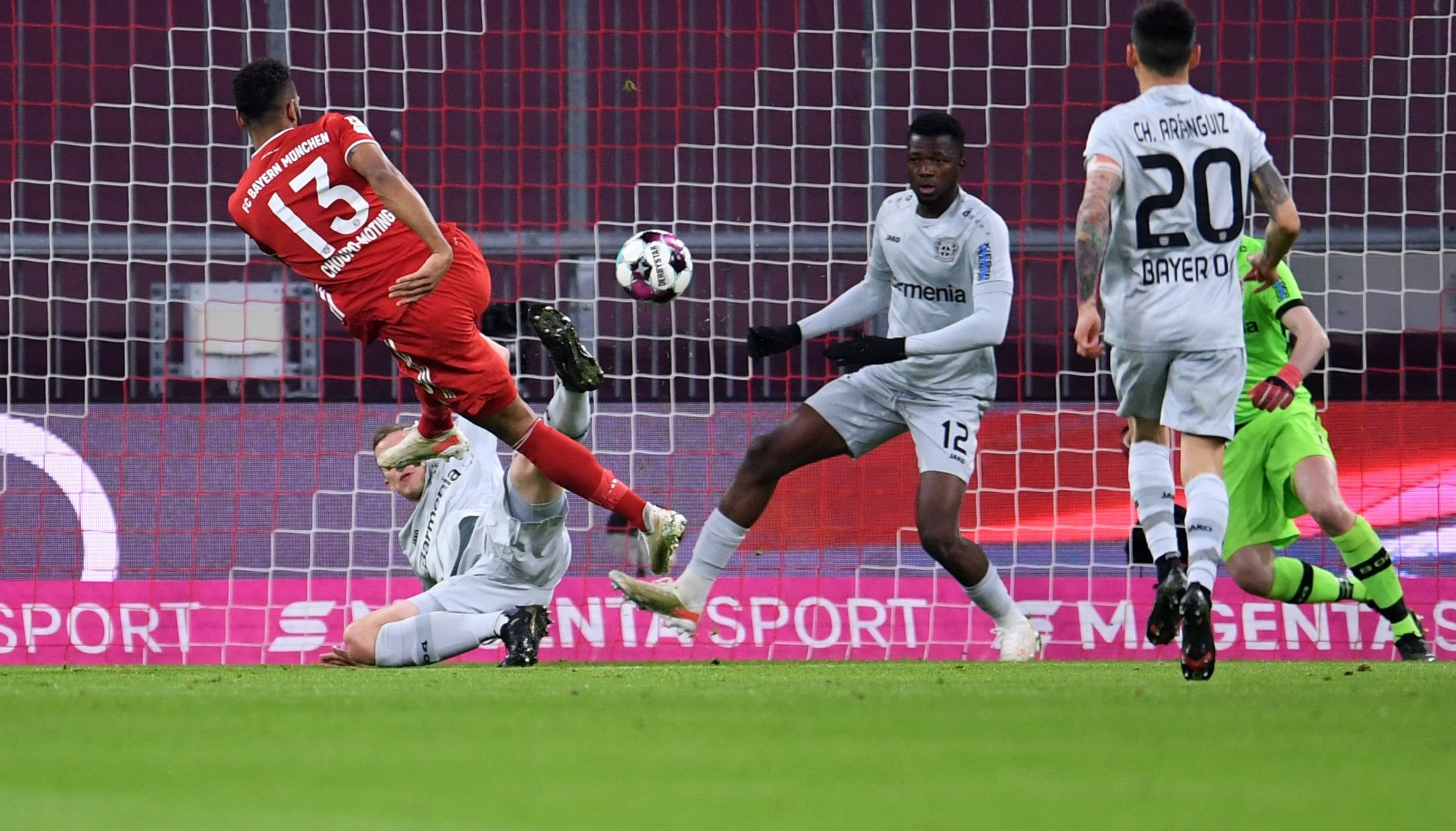 Bayern Munich's Cameroonian forward Eric Maxim Choupo-Moting (L) scores the opening goal during the German first division Bundesliga football match against Bayer 04 Leverkusen in Munich, southern Germany, on April 20, 2021. (Andreas Gebert/DFL/Pool via AFP)