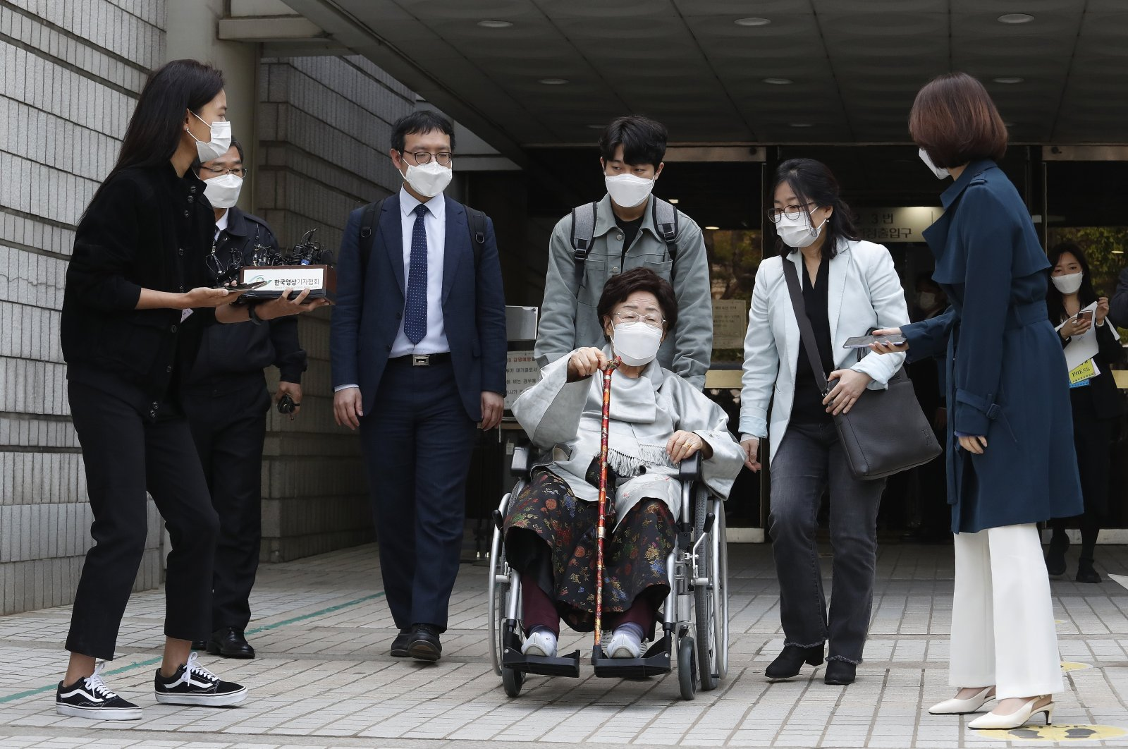 Former South Korean comfort woman Lee Yong-soo in a wheelchair leaves the Seoul Central District Court in Seoul, South Korea, Wednesday, April 21, 2021. (AP Photo)