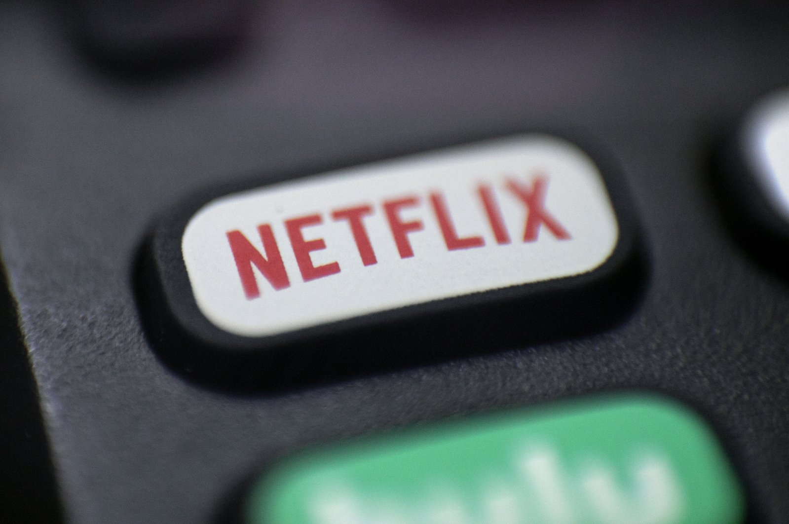 A Netflix logo is seen on a remote control in Portland, Oregon, Aug. 13, 2020. (AP Photo)