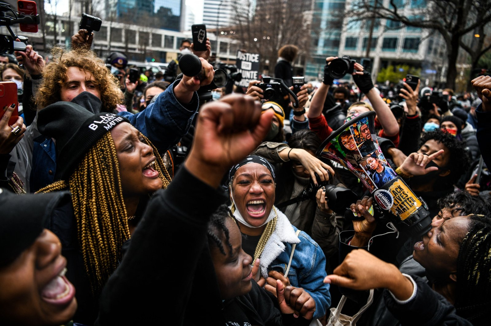 People celebrate as the verdict is announced in the trial of former police officer Derek Chauvin outside the Hennepin County Government Center in Minneapolis, Minnesota, U.S., April 20, 2021. (AFP Photo)