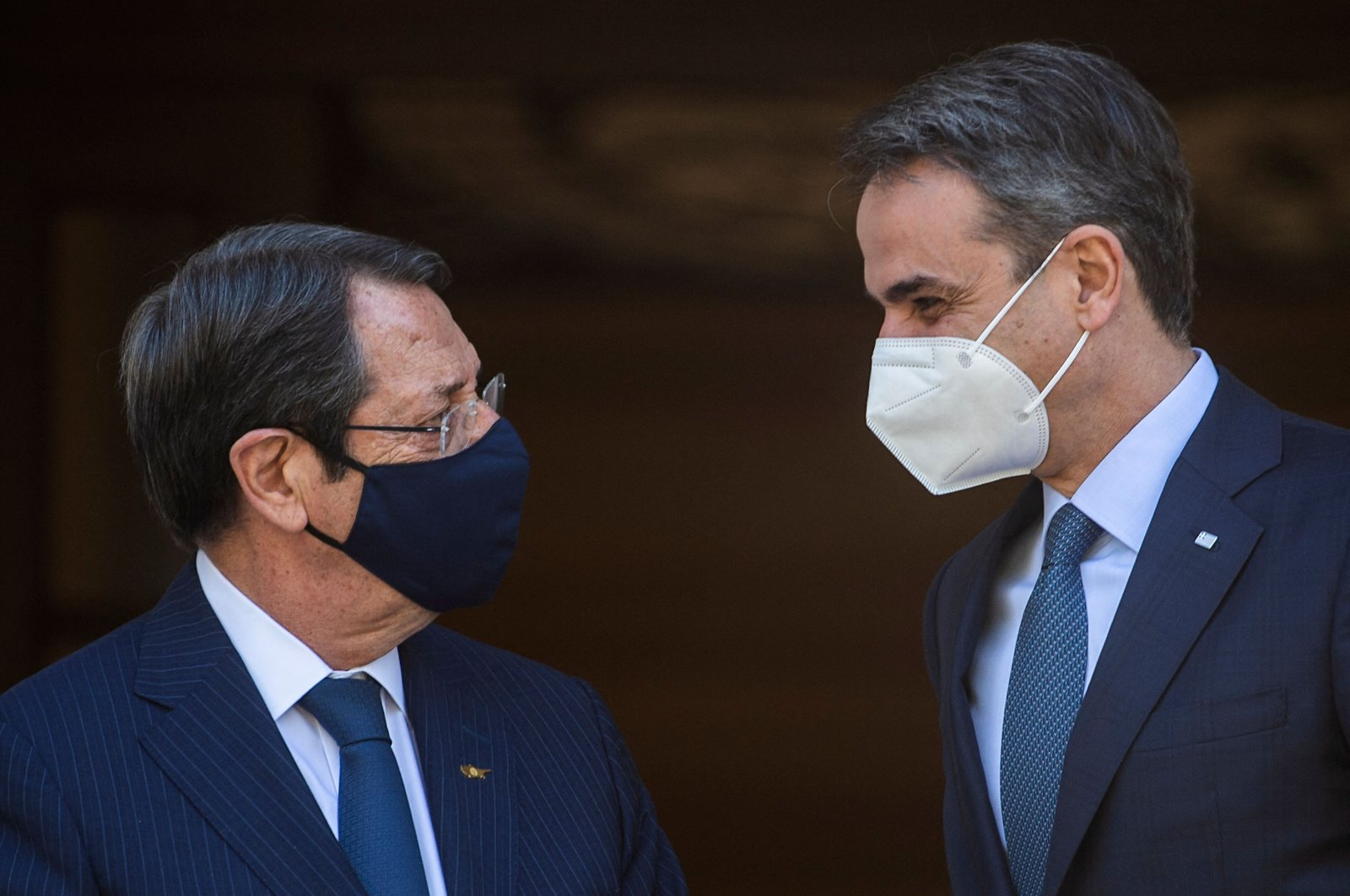 Greek Prime Minister Kyriakos Mitsotakis (R) welcomes Greek Cypriot leader Nicos Anastasiades (L) before their meeting at Maximos Mansion in Athens, Greece, April 21, 2021. (AFP)