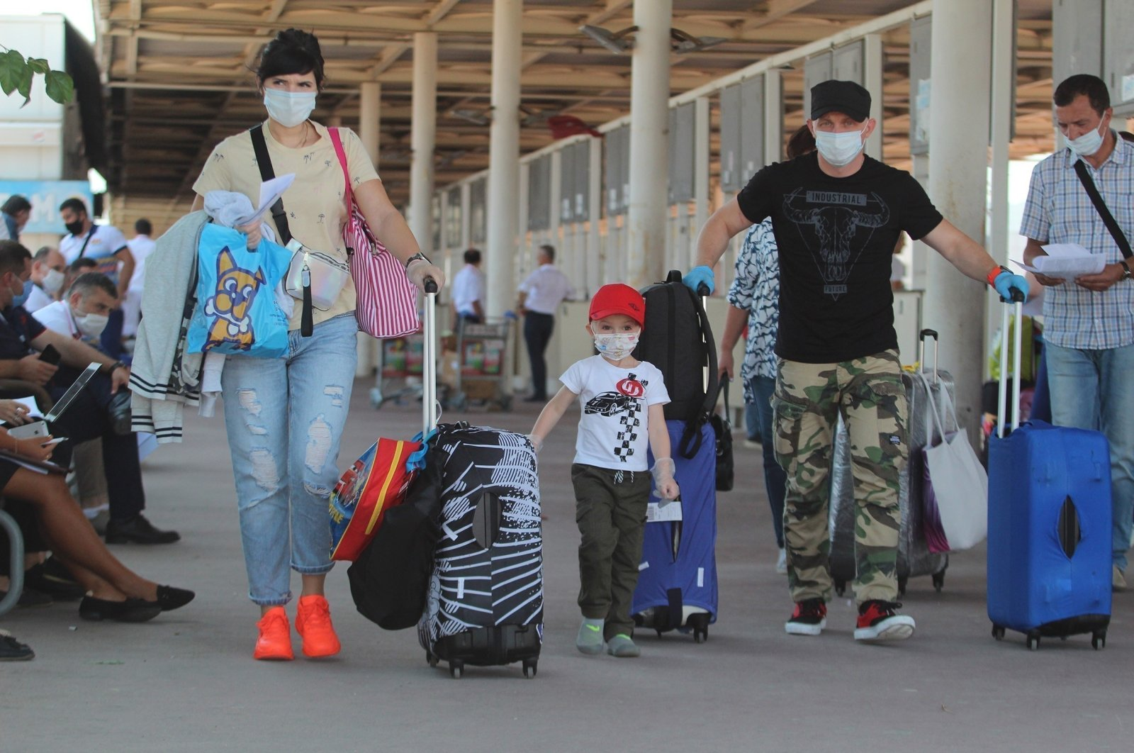 Tourists arrive at Antalya Airport, Antalya, southern Turkey, April 19, 2021. (IHA Photo)