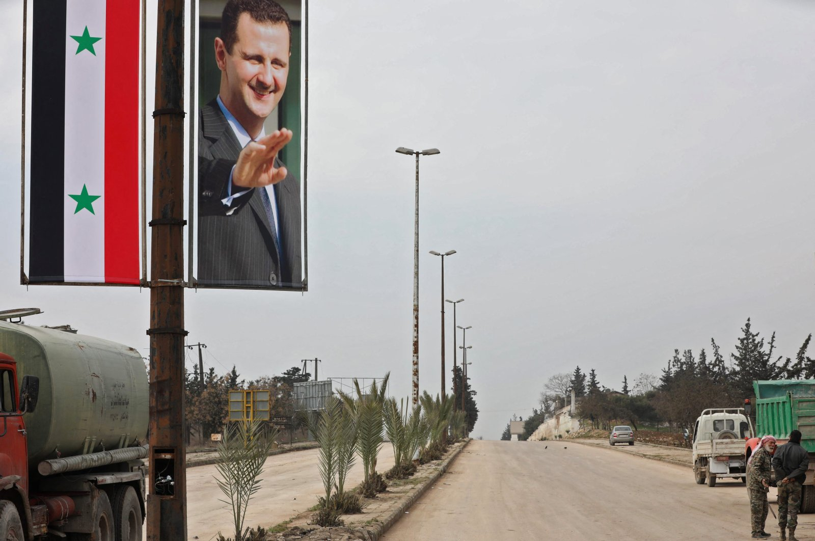 A poster of Syrian President Bashar al-Assad adorning the M5 highway connecting Aleppo to Damascus, Feb.18, 2020.  (Photo by LOUAI BESHARA / AFP)