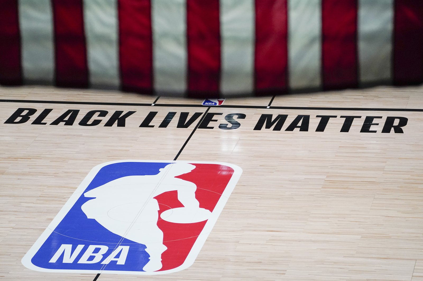 Black Lives Matter is displayed near the NBA logo in an empty basketball arena, Florida, U.S., Aug. 28, 2020. (AP Photo)