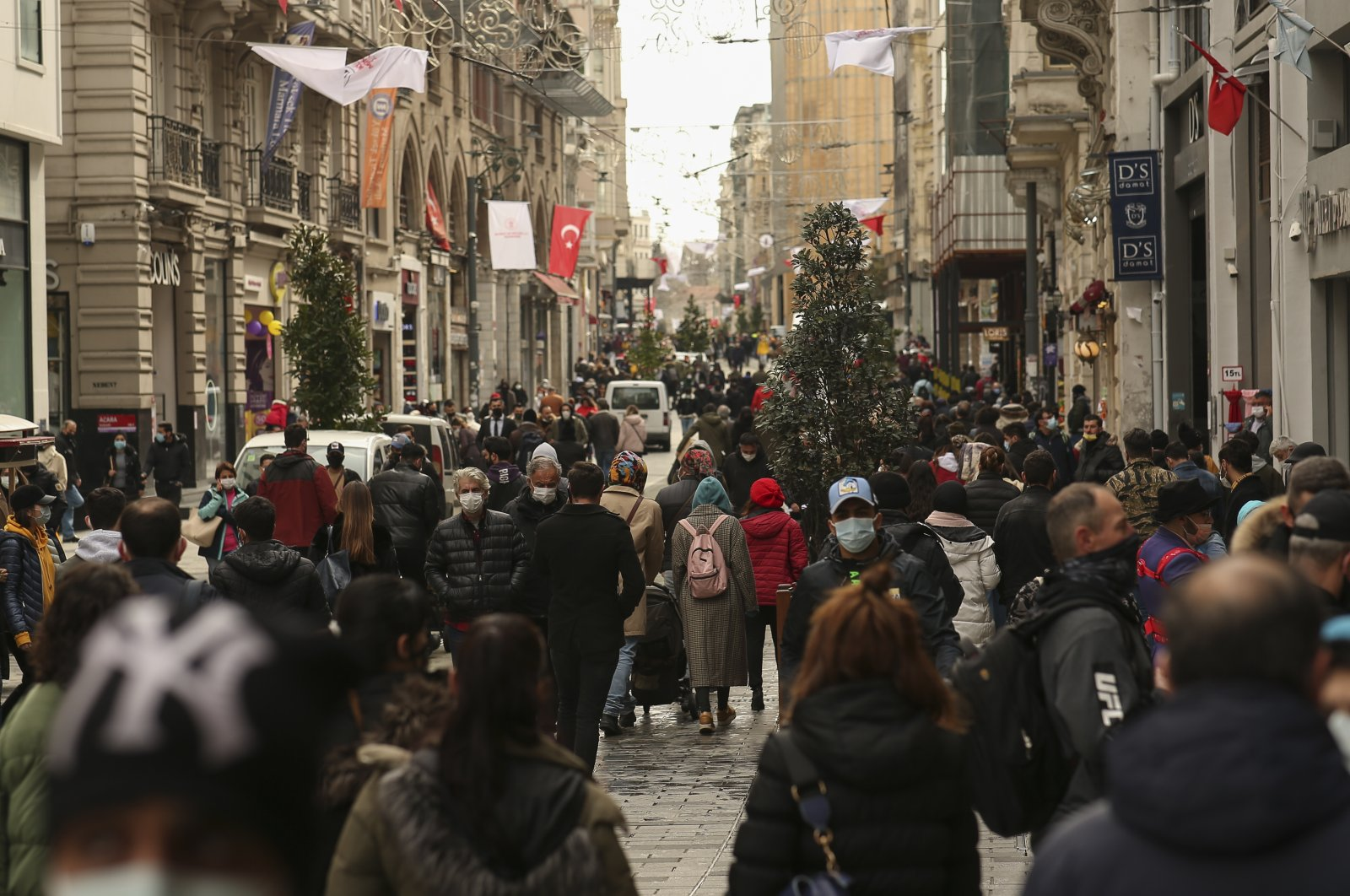 People walk in Istiklal Avenue, the main shopping street of Istanbul, Turkey, March 25, 2021. (AP Photo)