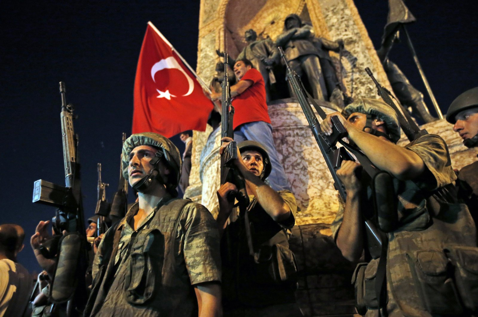 Turkish soldiers secure the area as supporters of Turkey's President Recep Tayyip Erdogan protest in Istanbul's Taksim square, July 16, 2016. (AP)