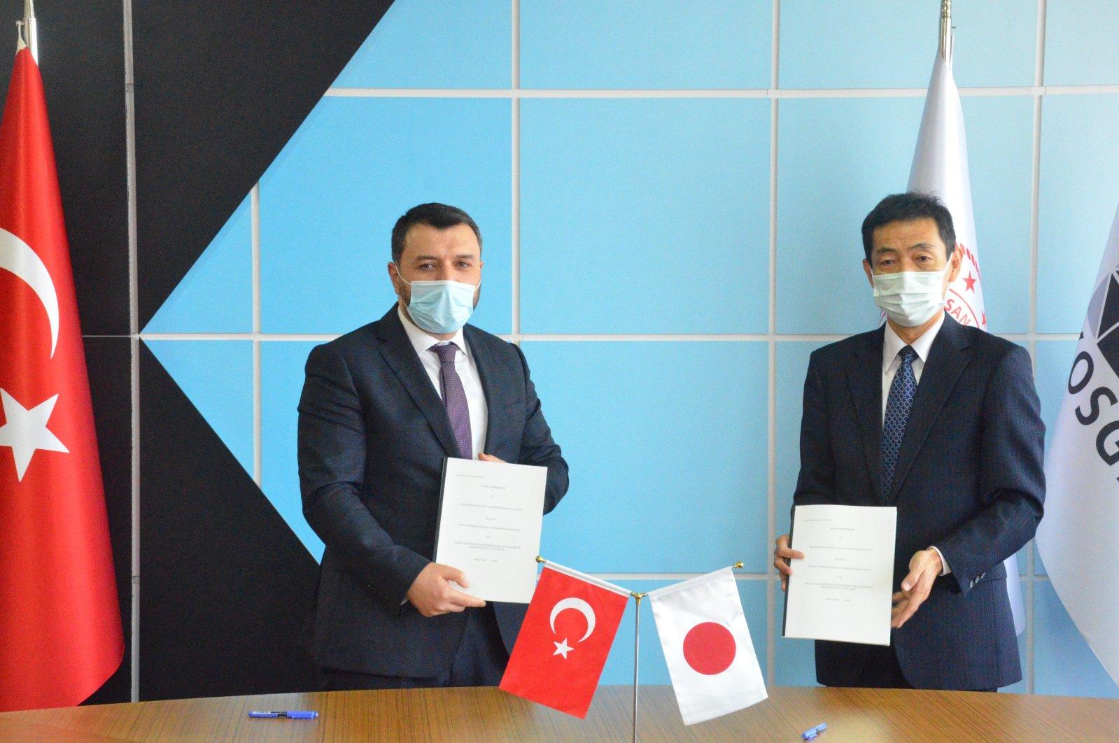 Small and Medium Industry Development Organization (KOSGEB) head Hasan Basri Kurt (L) and Japan International Cooperation Agency (JICA) Turkey head Nobuhiro Ikuro during a signing ceremony, Istanbul, Turkey, April, 21, 2021. (IHA Photo)