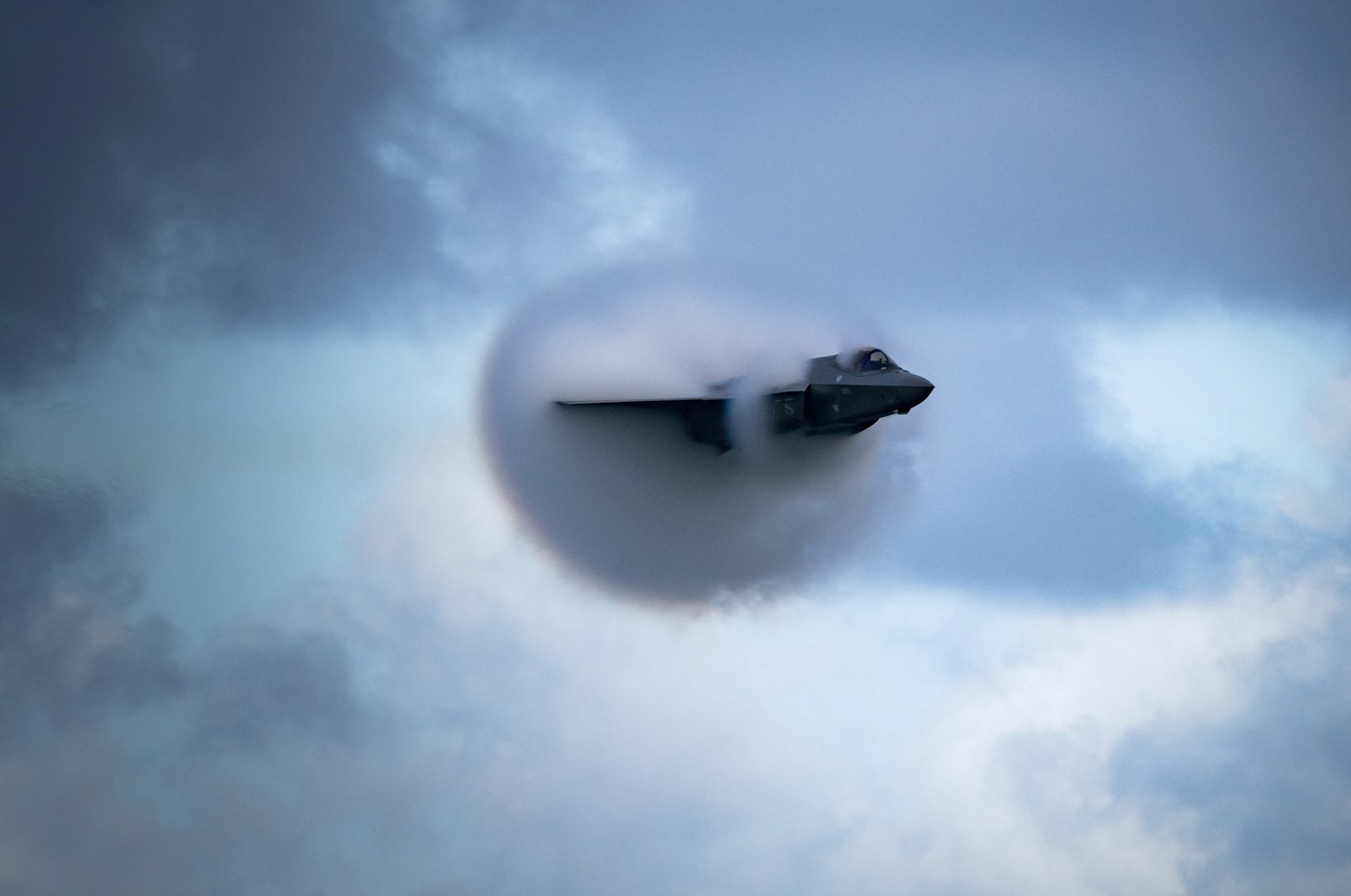"""F-35 Lightning II pilot, U.S. Air Force Captain Kristin """"BEO"""" Wolfe, performs the """"high-speed pass"""" maneuver at approximately .95 mach, which is just below the speed of sound, at the 2020 Fort Lauderdale Air Show in Fort Lauderdale, Florida, U.S. November 22, 2020. (U.S. Air Force via Reuters)"""