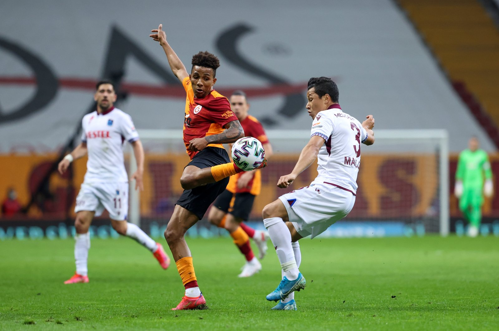 Galatasaray's Gedson Carvalho Fernandes (L) and Trabzonspor's Marlon Rodrigues Xavier compete for the ball during a Süper Lig match at Türk Telekom Arena in Istanbul, Turkey, April 21, 2021. (AA Photo)