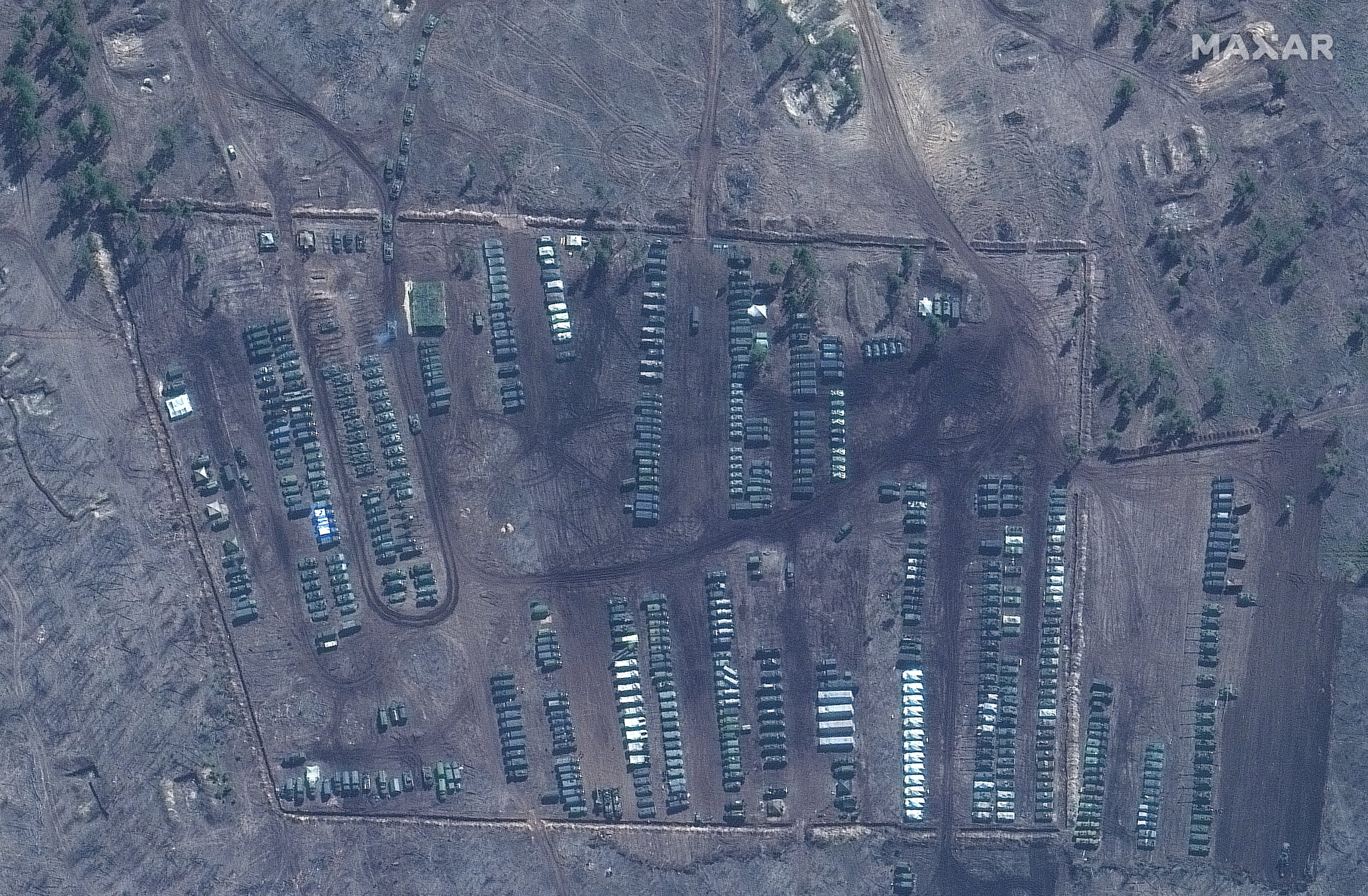 A satellite image of tanks and military equipment at the Pogorovo training area near Voronezh, Russia, Saturday, April 10, 2021. (Maxar Technologies via AP)