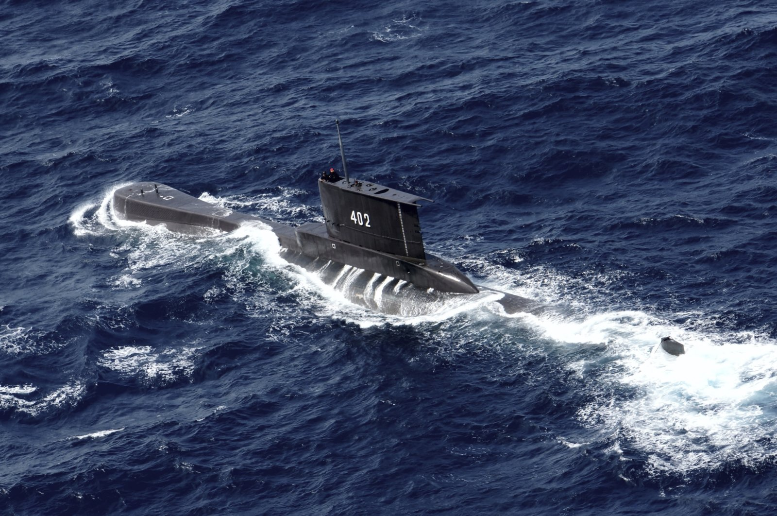 Indonesian Navy submarine KRI Nanggala sails in the waters off Tuban, East Java, Indonesia, as seen in this aerial photo taken from an Indonesian Navy helicopter from the 400 Air Squadron, Oct. 6, 2014. (AP Photo)