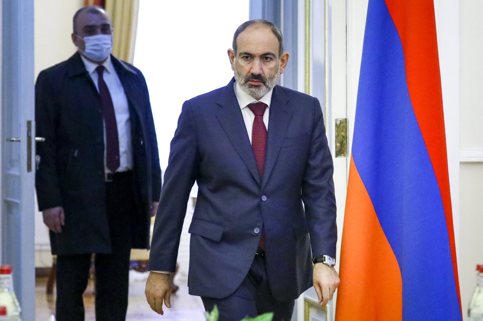 Armenia's Prime Minister Nikol Pashinian enters a hall for a meeting with Russian Foreign Minister Sergey Lavrov in Yerevan, Armenia, Saturday, Nov. 21, 2020. (Russian Foreign Ministry Press Service via AP)