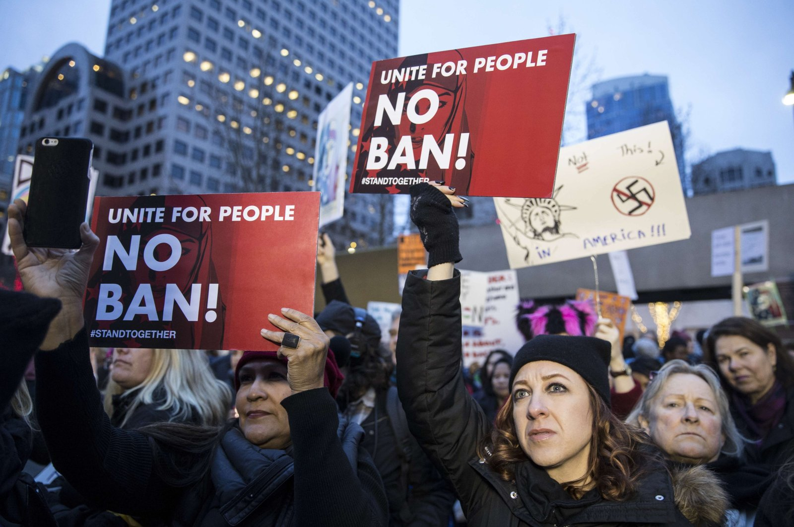 Protestors hold up signs while taking part in a demonstration against former President Donald Trump's executive order banning Muslims from certain countries, Seattle, Washington, U.S., Jan. 29, 2017. (Stephen Brashear/Getty Images via AFP)